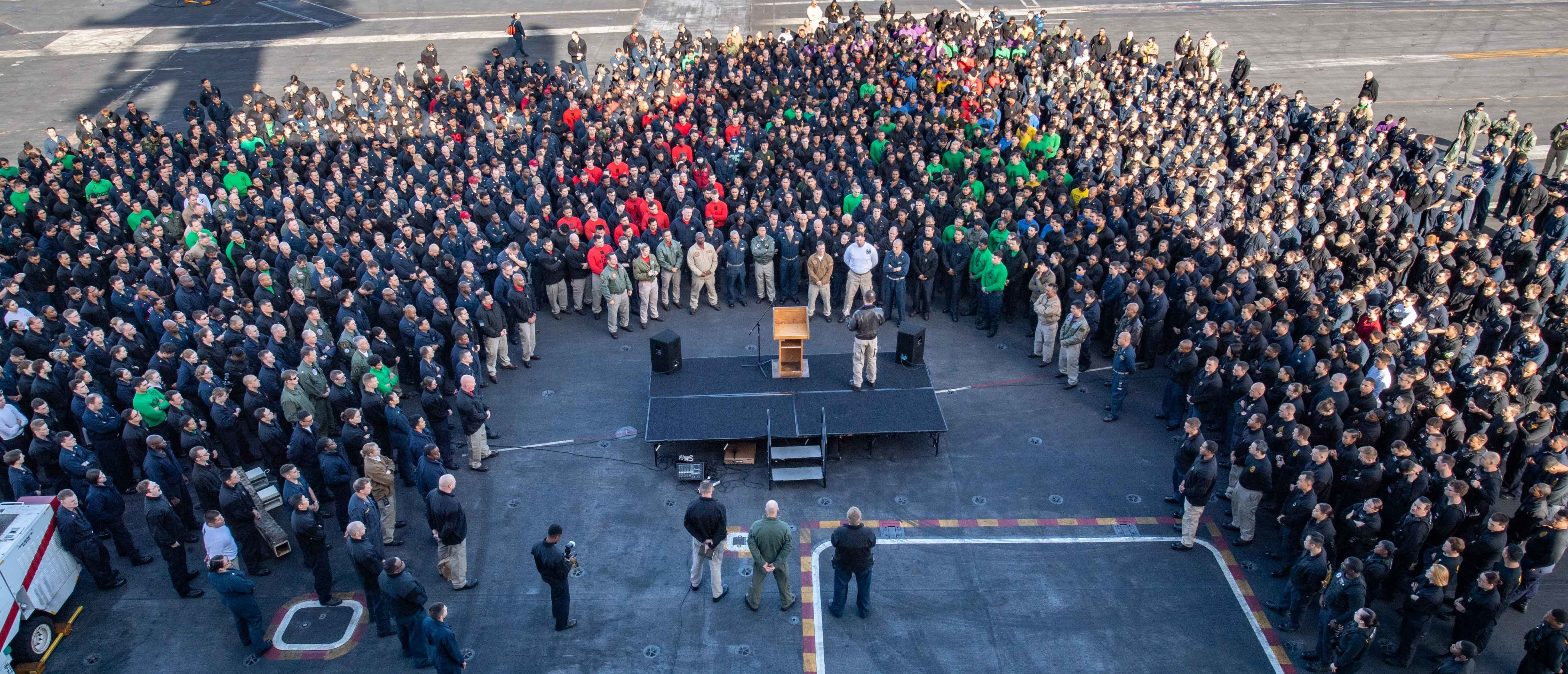 PACIFIC OCEAN - DECEMBER 15: In this handout released by the U.S. Navy, Capt. Brett Crozier, commanding officer of the aircraft carrier USS Theodore Roosevelt (CVN 71), addresses the crew during an all hands call on the ships flight deck Dec. 15, 2019. Theodore Roosevelt is currently underway conducting routine training in the Eastern Pacific Ocean. (Photo by U.S. Navy via Getty Images)