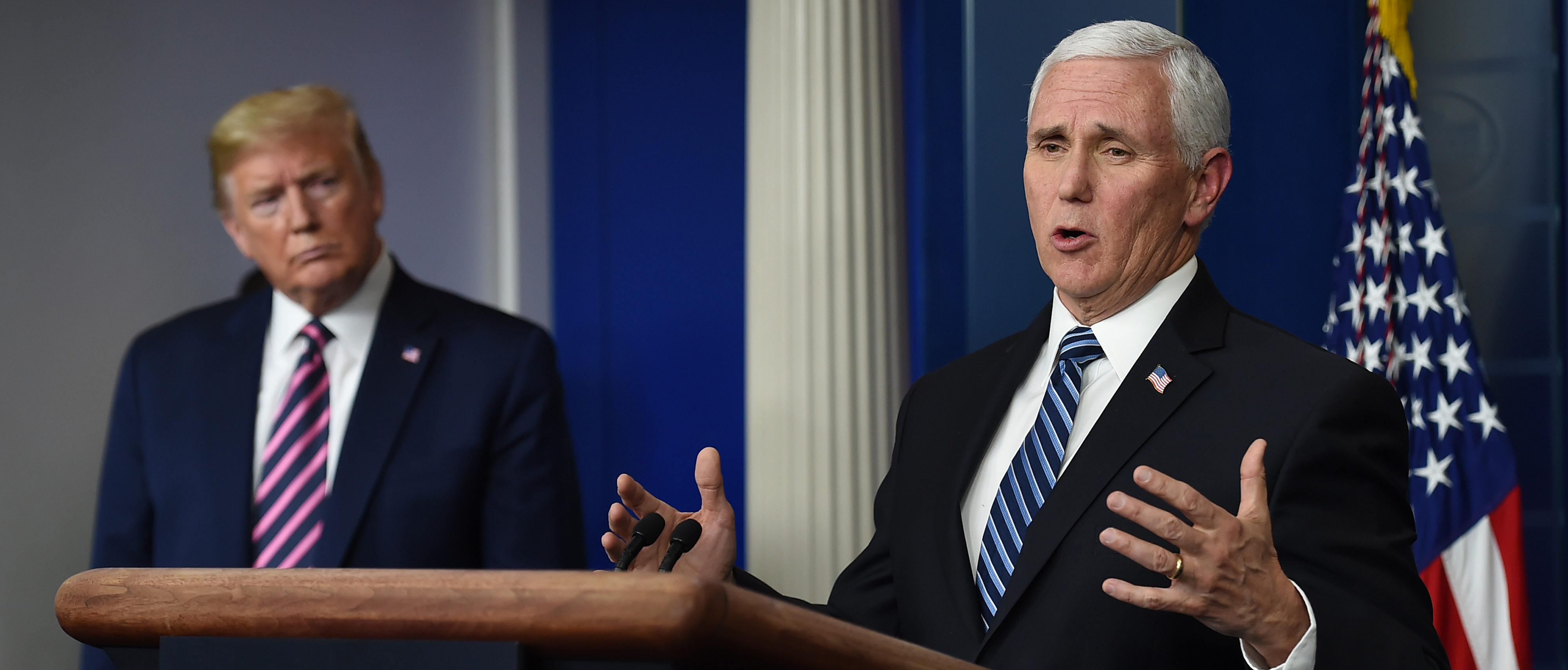 US President Donald Trump listens as US Vice President Mike Pence speaks during the daily briefing on the novel coronavirus, which causes COVID-19, in the Brady Briefing Room of the White House on April 24, 2020, in Washington, DC (Photo by OLIVIER DOULIERY/AFP via Getty Images)