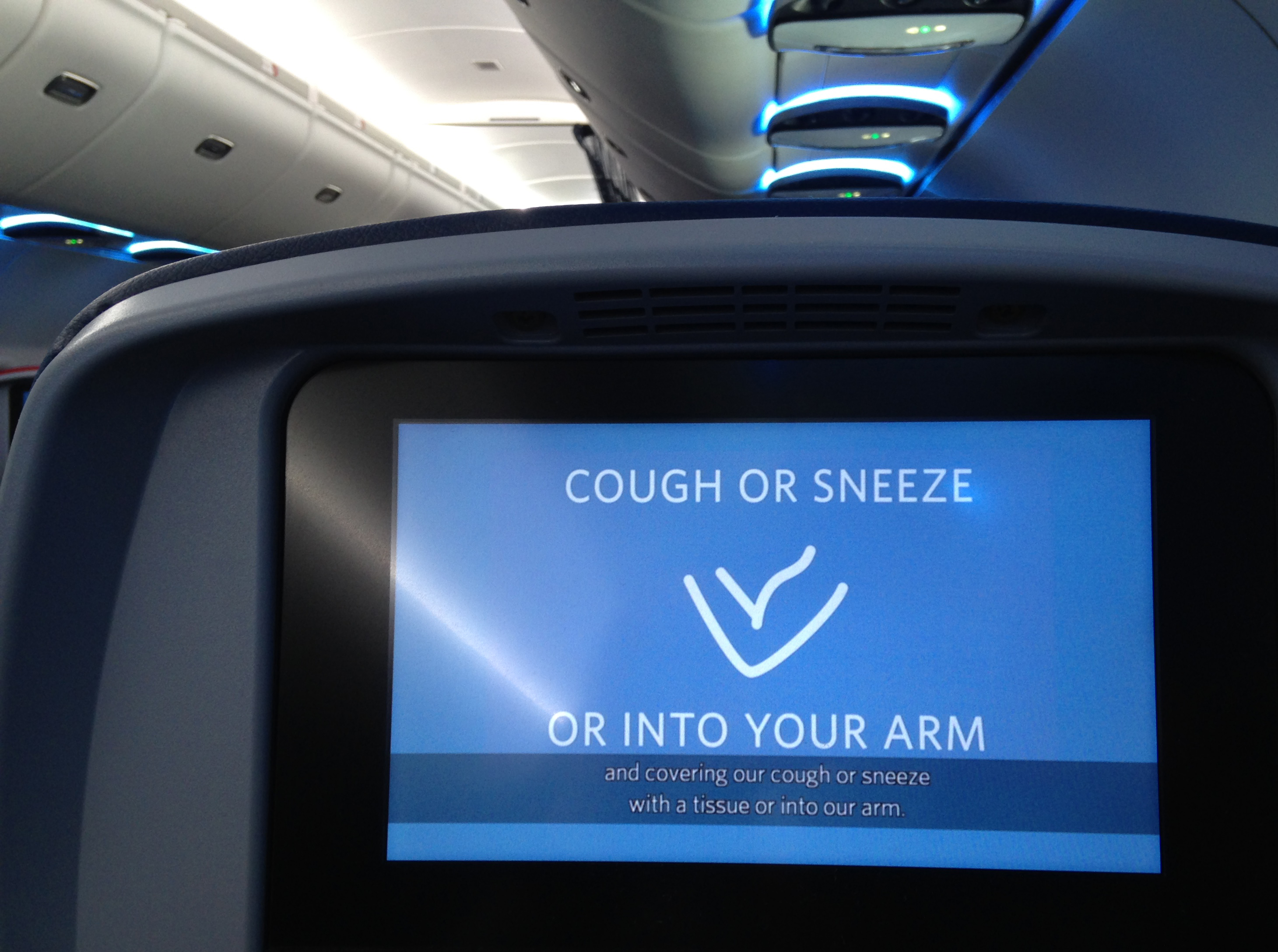 A video invites passengers to safely cough in their elbows before a Delta flight departs from MinneapolisSaint Paul International Airport on April 25, 2020. (Photo by SEBASTIEN DUVAL/AFP via Getty Images)