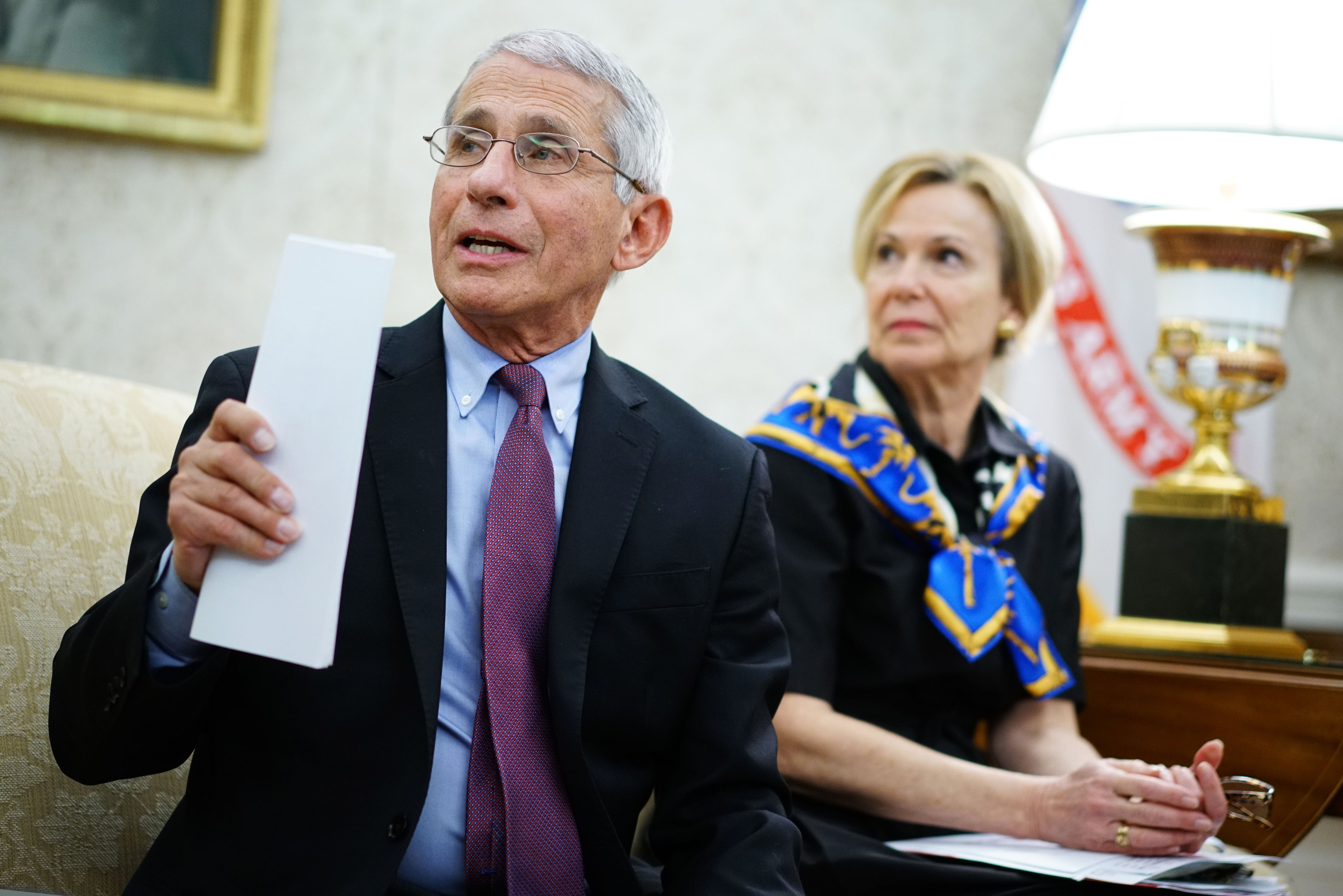 Dr. Anthony Fauci (L), director of the National Institute of Allergy and Infectious Diseases speaks next to Response coordinator for White House Coronavirus Task Force Deborah Birx, during a meeting with US President Donald Trump and Louisiana Governor John Bel Edwards D-LA in the Oval Office of the White House in Washington, DC on April 29, 2020. (Photo by MANDEL NGAN/AFP via Getty Images)