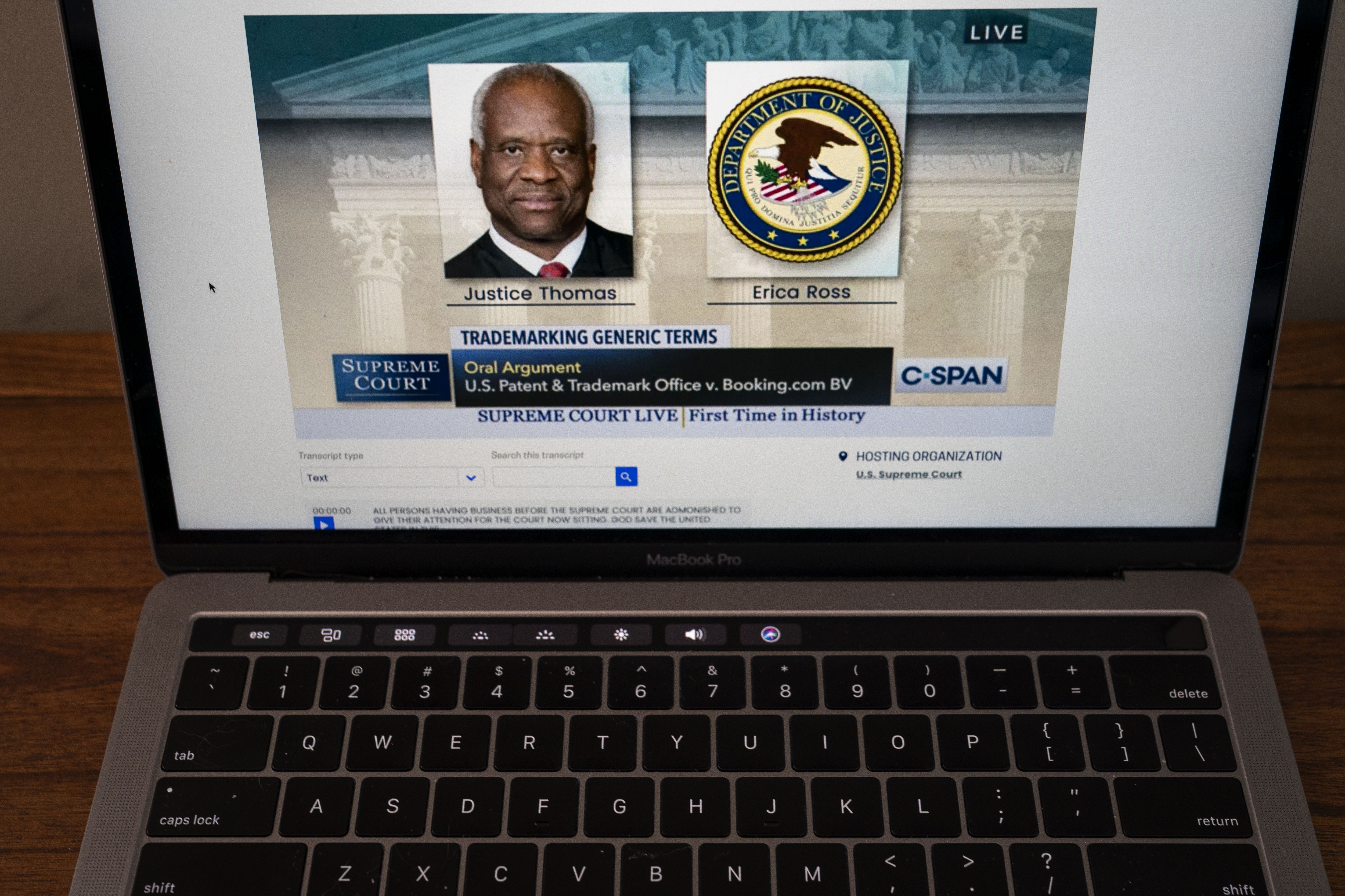 In this illustration photo, Associate Justice Clarence Thomas speaks during oral arguments before the Supreme Court in the case U.S. Patent and Trademark Office v. Booking.com as it is live streamed on a laptop, May 4, 2020 Washington, DC. (Drew Angerer/Getty Images)