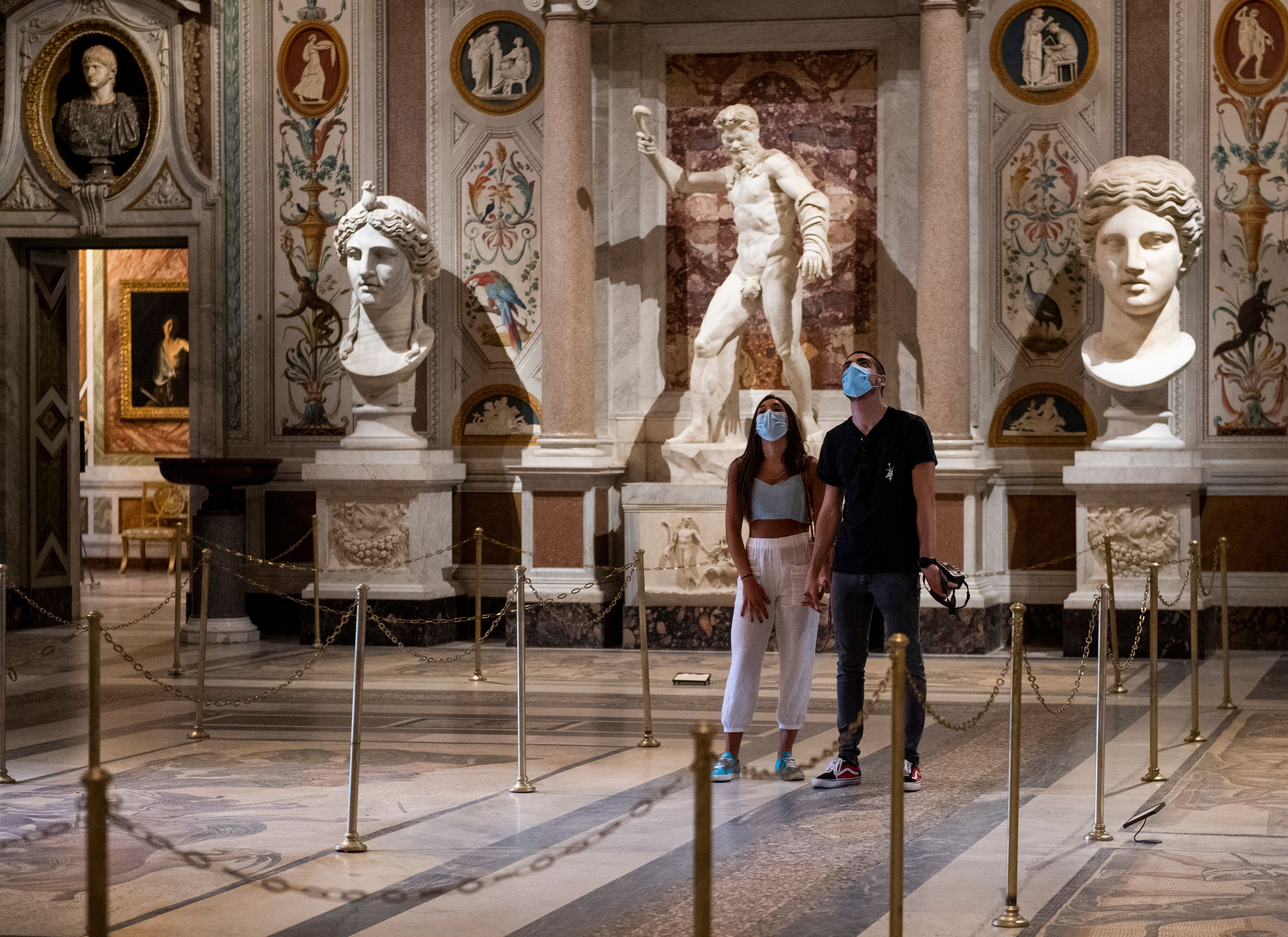 Visitors wearing a face mask view a room at the Galleria Borghese museum in Rome on May 19, 2020, as it reopens while the country's lockdown is easing after over two months. (Photo by TIZIANA FABI/AFP via Getty Images)