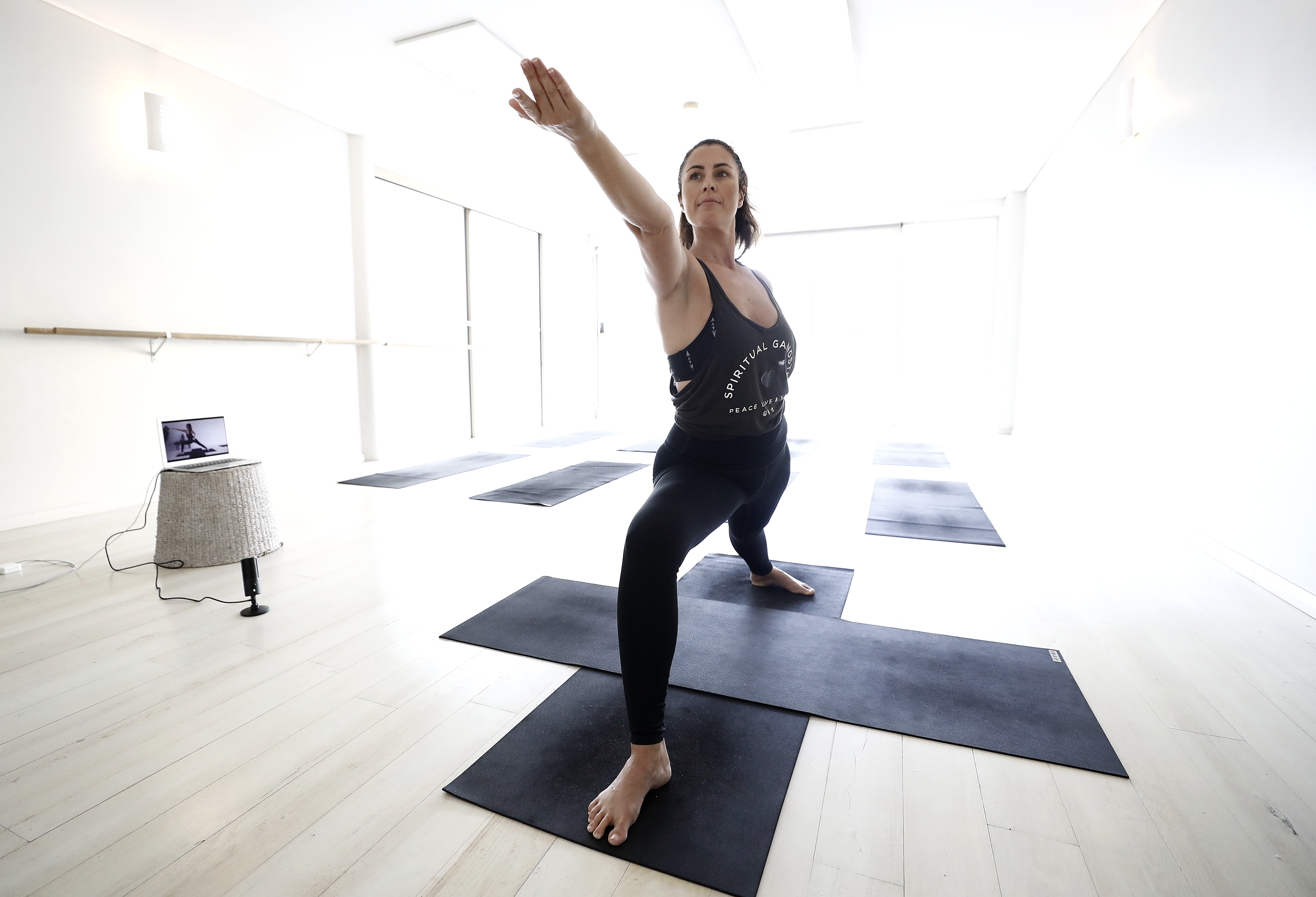 Yoga instructor Asha Elliott conducts a live stream Yoga class at the Clovelly 'This is Yoga' studio on March 23, 2020 in Sydney, Australia. (Photo by Ryan Pierse/Getty Images)