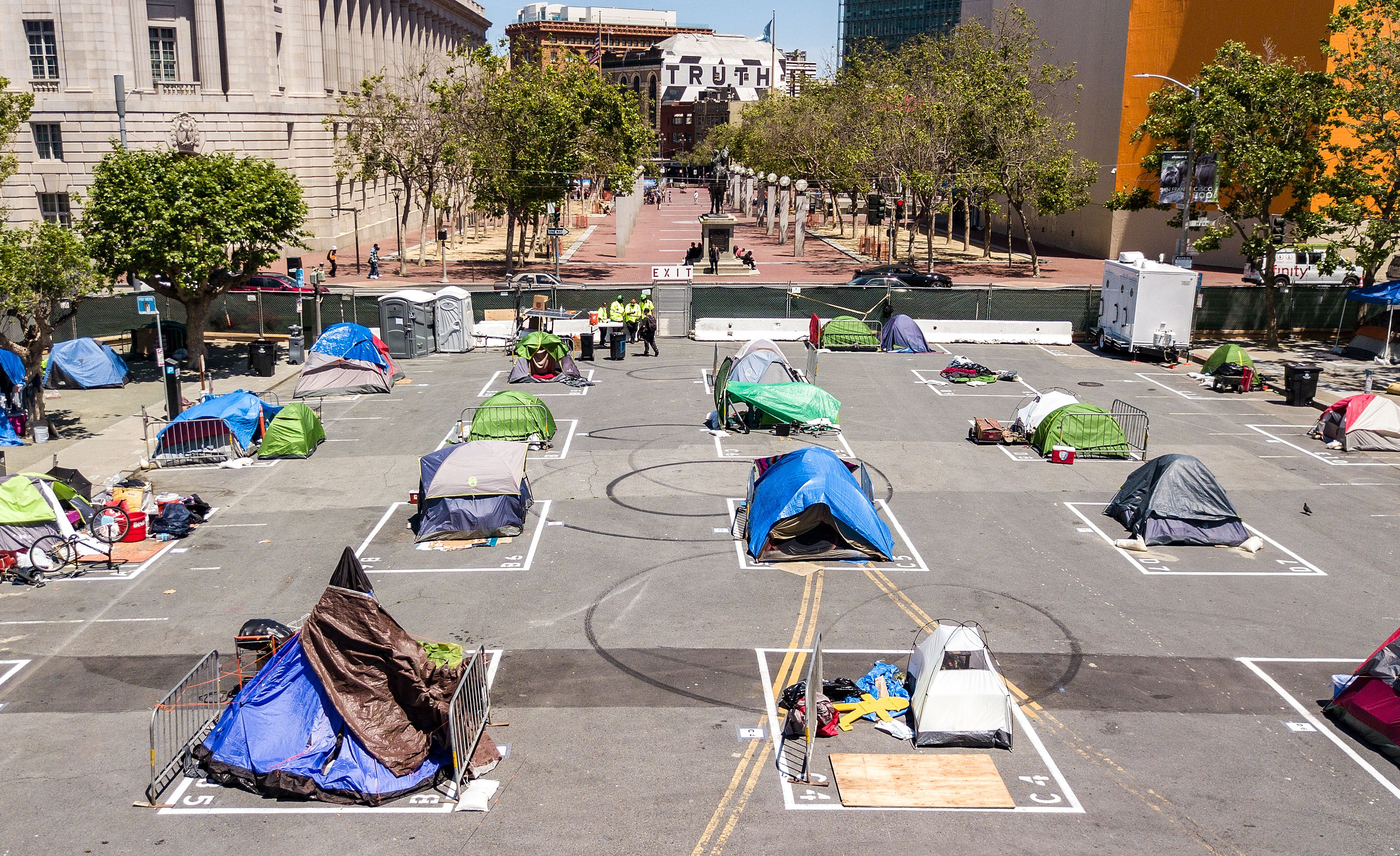 Rectangles are painted on the ground to encourage homeless people to keep social distancing at a city-sanctioned homeless encampment across from City Hall in San Francisco, California, on May 22, 2020, amid the novel coronavirus pandemic. (Photo by JOSH EDELSON/AFP via Getty Images)