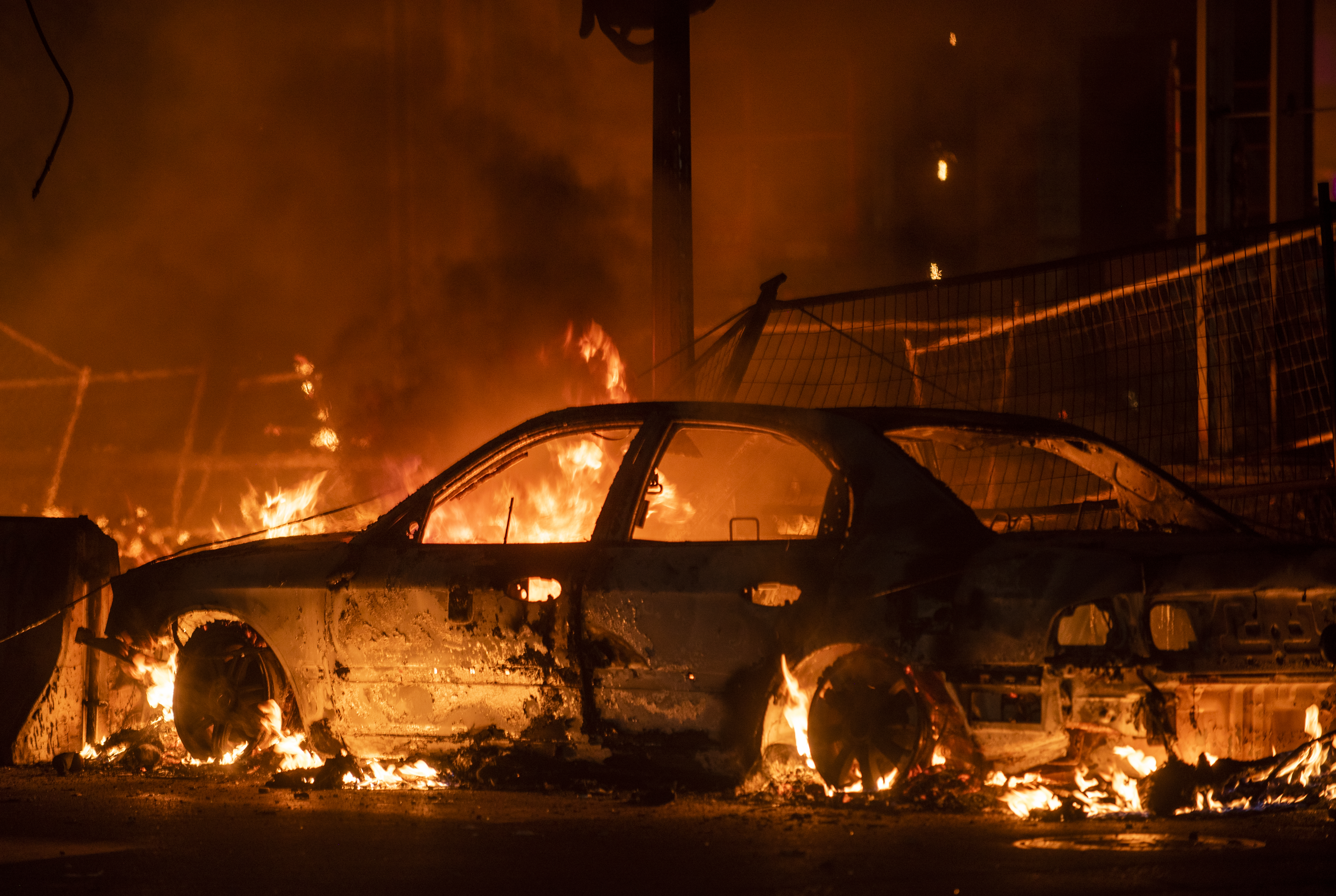 A car burns near the Third Police Precinct on May 27, 2020 in Minneapolis, Minnesota. (Stephen Maturen/Getty Images)