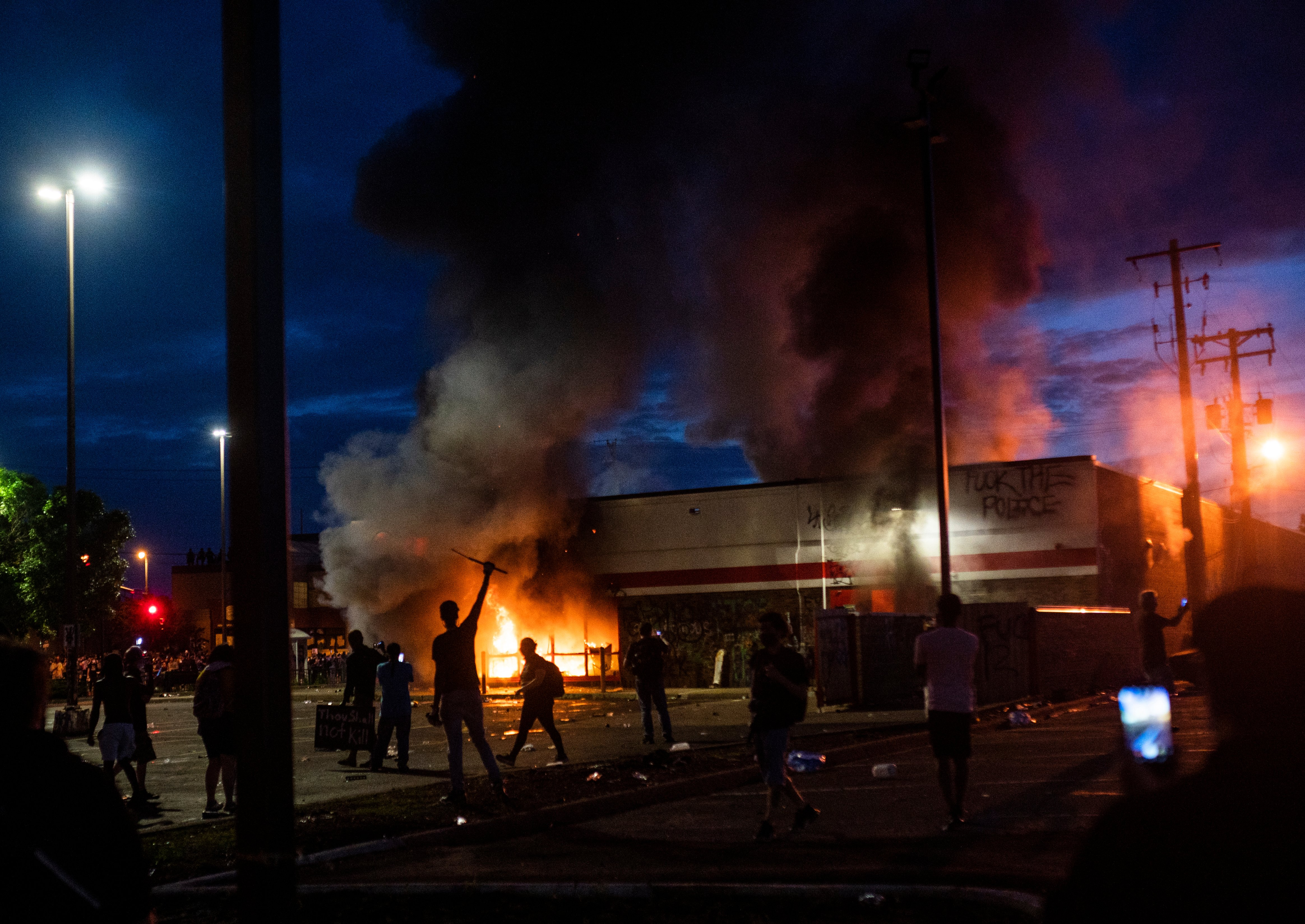(EDITOR'S NOTE: Alternate crop.) A fire burns inside of an Auto Zone store near the 3rd Police Precinct on May 27, 2020 in Minneapolis, Minnesota. (Stephen Maturen/Getty Images)