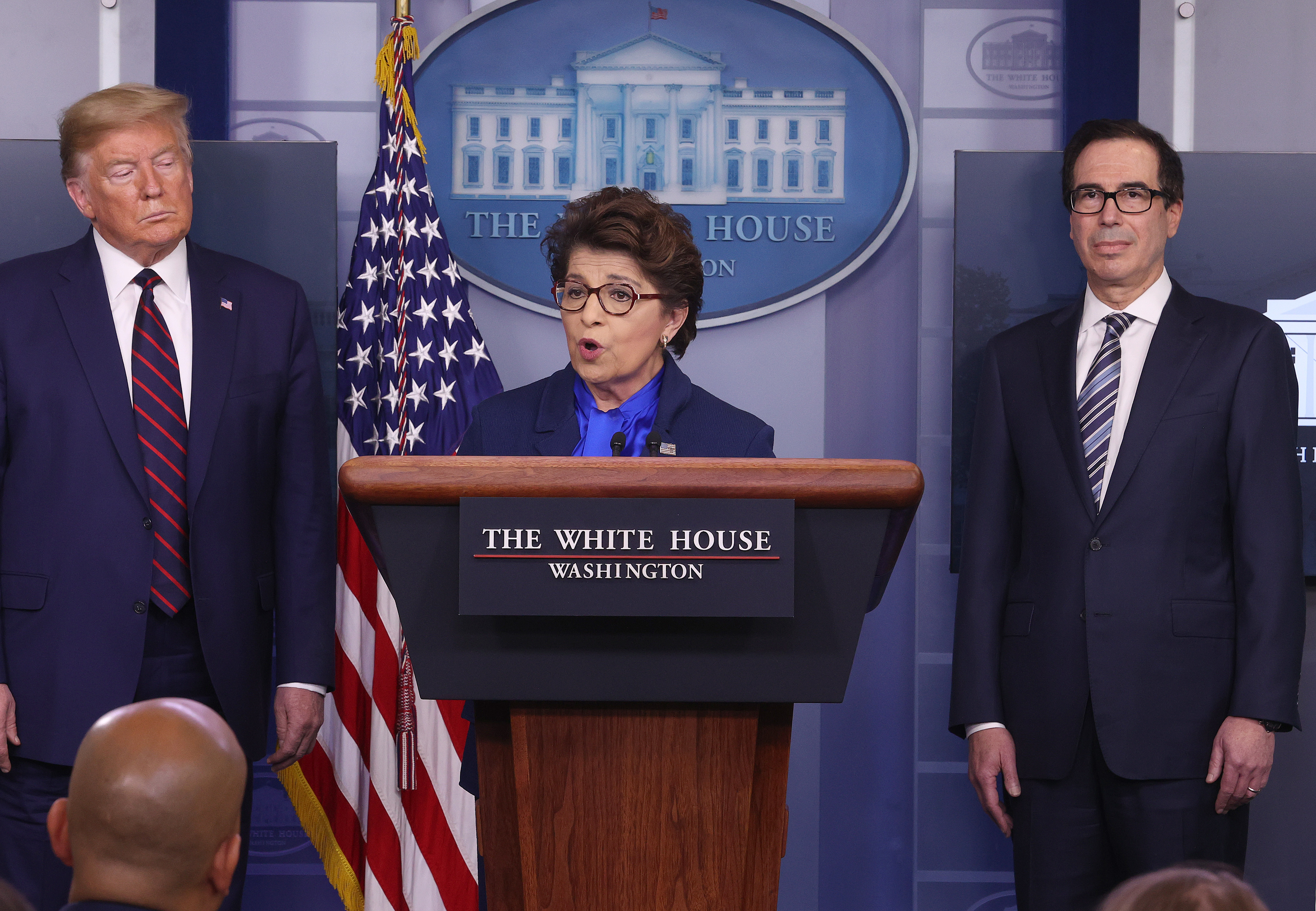 WASHINGTON, DC - APRIL 02: Small Business Administrator, Jovita Carranza speaks while flanked by U.S. President Donald Trump and Secretary of Treasury Steve Mnuchin (R) in the press briefing room with members of the White House Coronavirus Task Force April 2, 2020 in Washington, DC. The U.S. government reported an unprecedented 6.6 million jobless claims this morning as a result of the coronavirus outbreak. (Photo by Win McNamee/Getty Images)