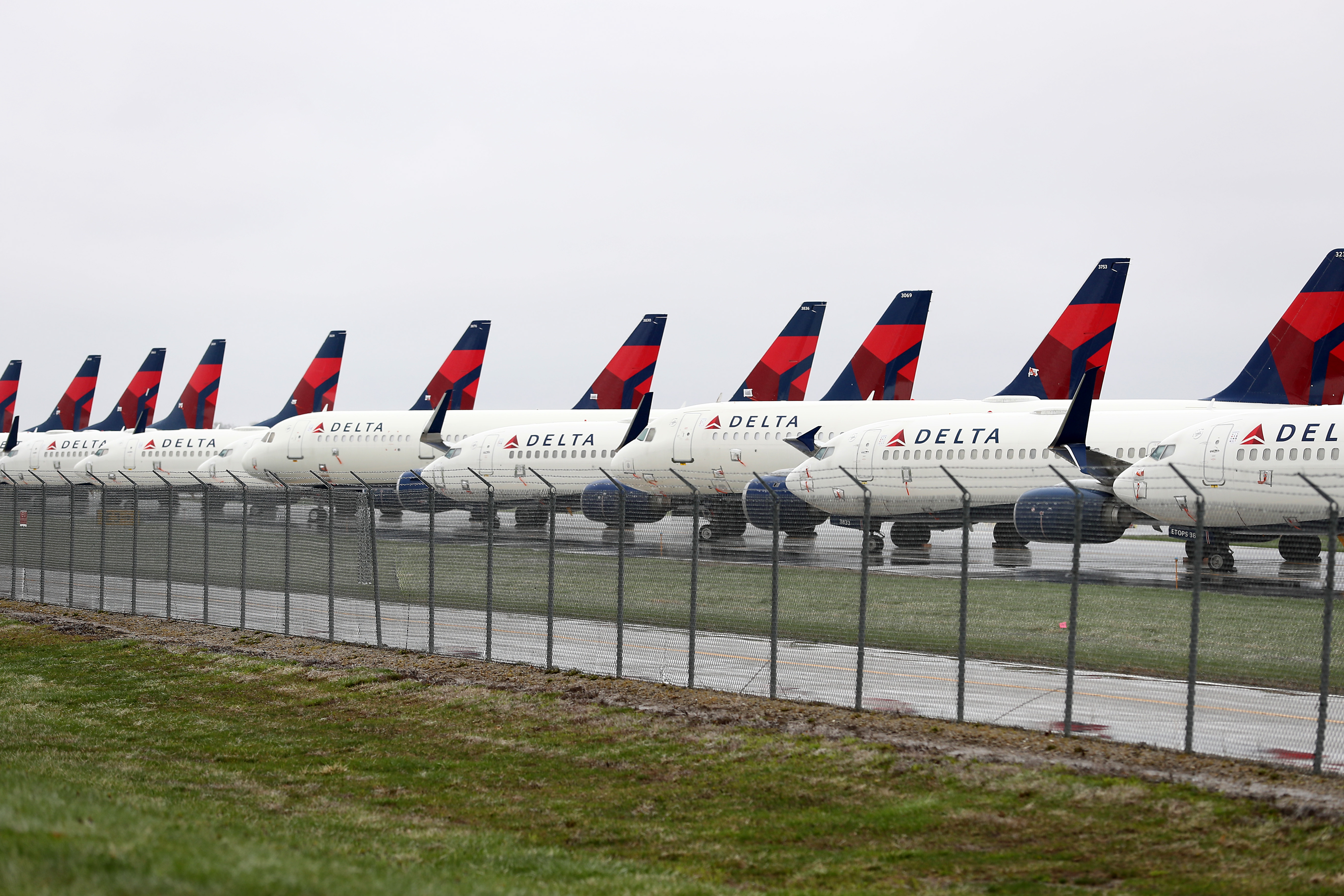 Planes belonging to Delta Air Lines sit idle at Kansas City International Airport on April 03, 2020 in Kansas City, Missouri. (Photo by Jamie Squire/Getty Images)