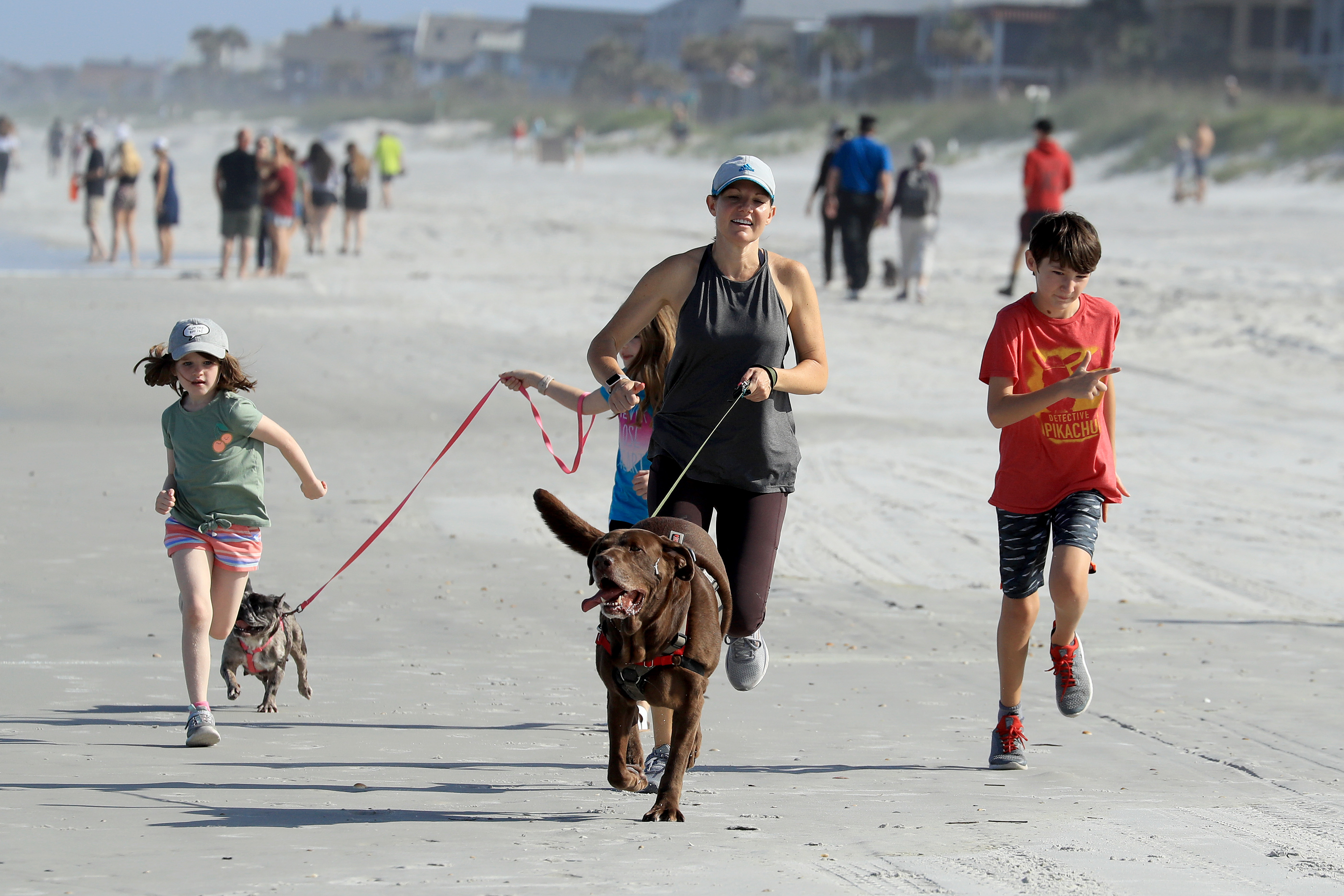 People run on the beach on April 17, 2020 in Jacksonville Beach, Florida. (Photo by Sam Greenwood/Getty Images)