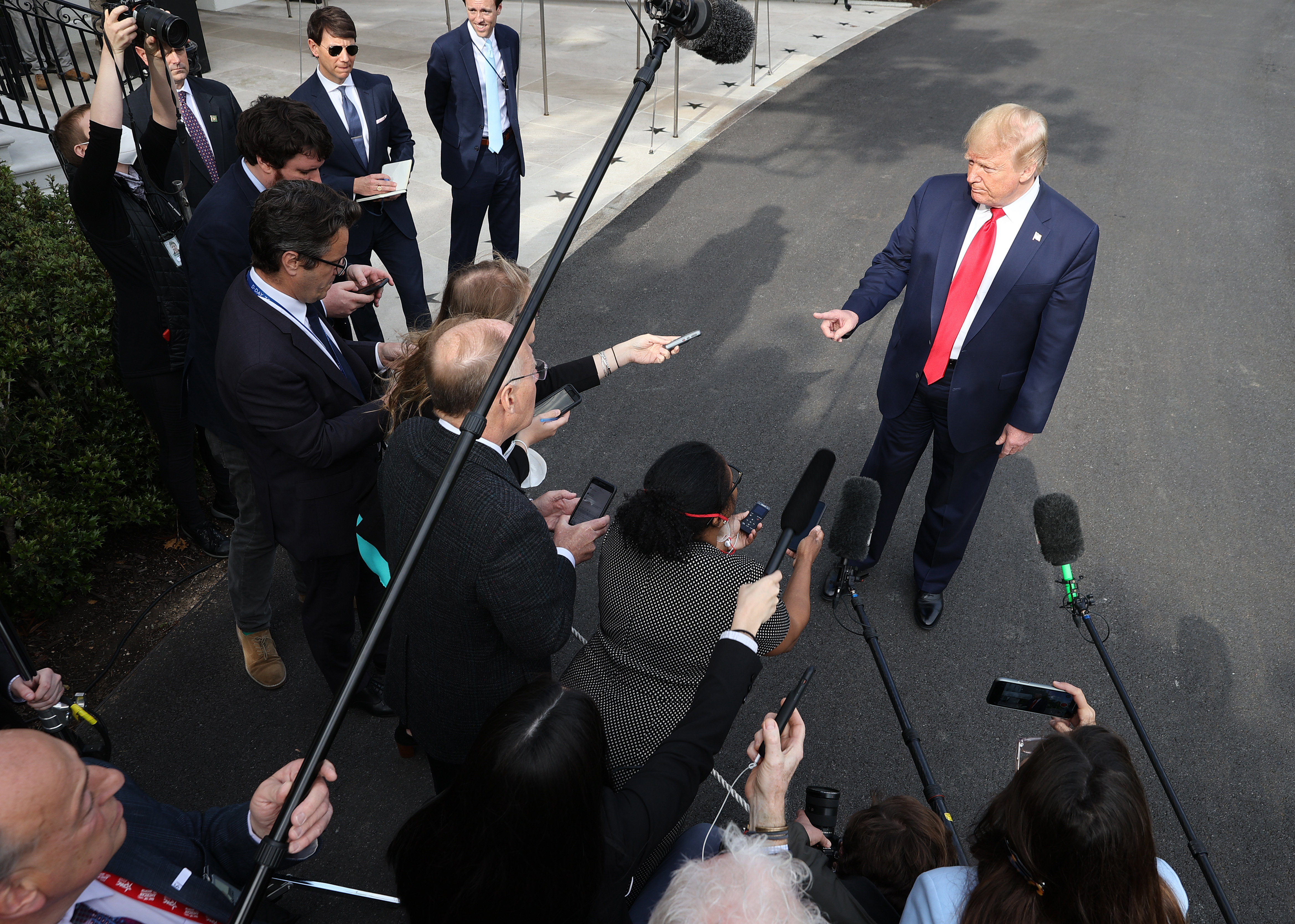WASHINGTON, DC - MAY 01: U.S. President Donald Trump talks to journalists on the South Lawn while departing the White House for Camp David May 01, 2020 in Washington, DC. According to White House Press Secretary Kayleigh McEnany, Trump will spend a 'working weekend' at the camp outside of Washington with a small group of aides, including chief of staff Mark Meadows and daughter Ivanka Trump. (Photo by Chip Somodevilla/Getty Images)