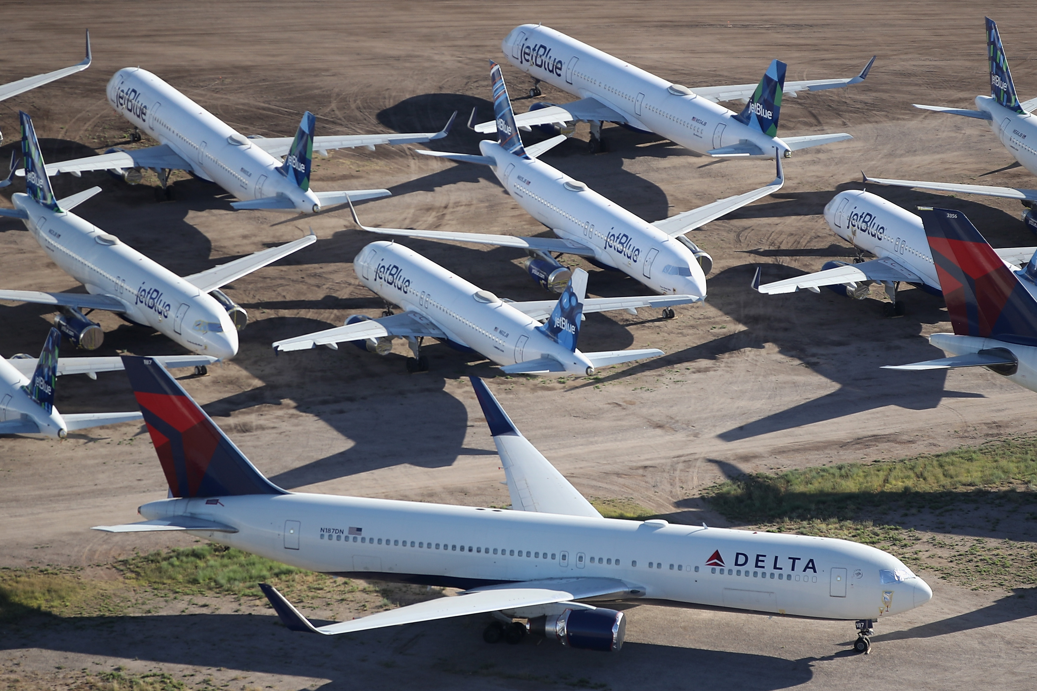 Decommissioned and suspended Delta and jetBlue commercial aircrafts are seen stored in Pinal Airpark on May 16, 2020 in Marana, Arizona. (Photo by Christian Petersen/Getty Images)