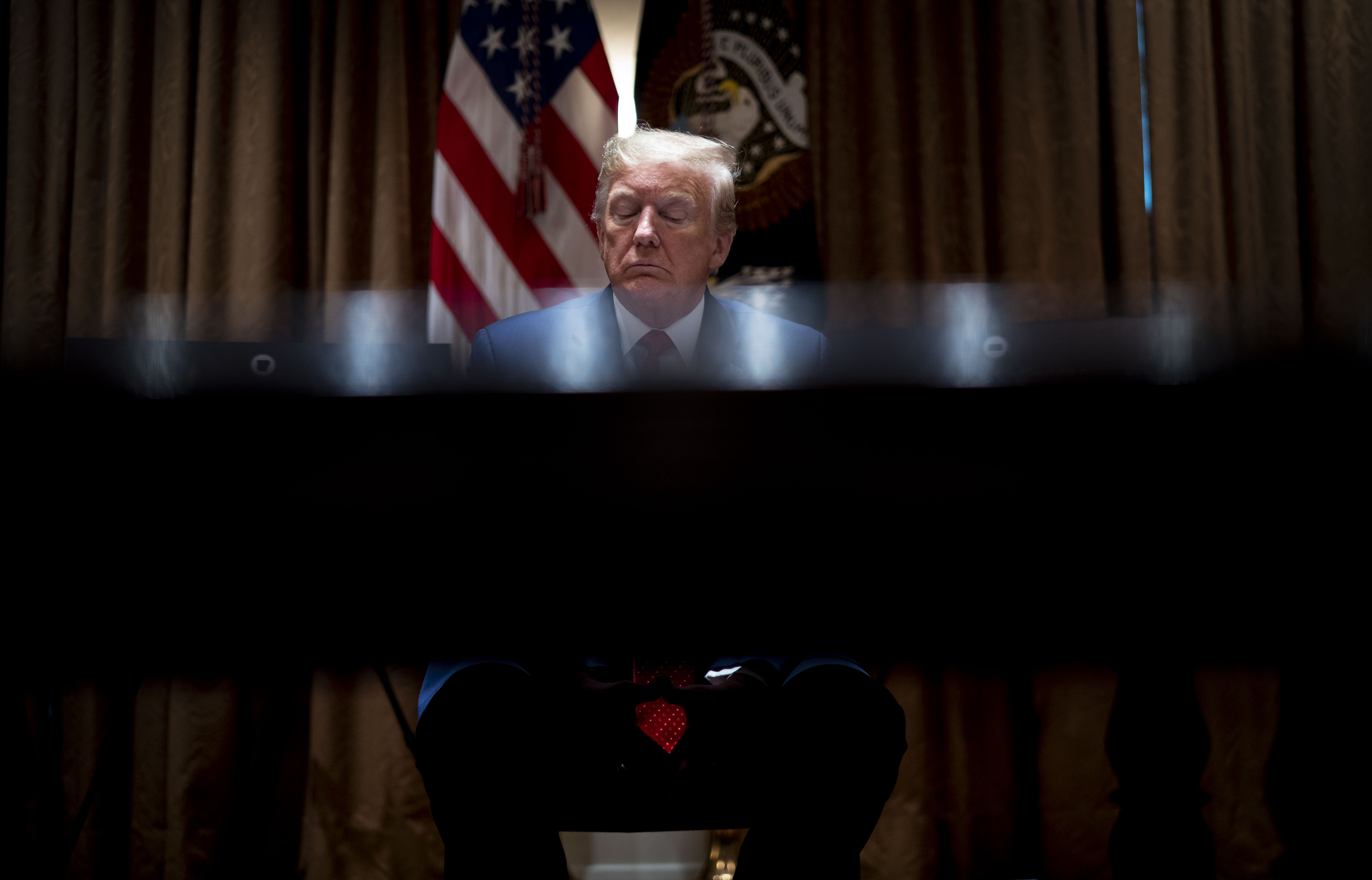 WASHINGTON, DC - MAY 20: U.S. President Donald Trump pauses during a meeting with the Arkansas Governor Asa Hutchinson and Kansas Governor Laura Kelly in the Cabinet Room of the White House May 20, 2020 in Washington, DC. (Photo by Doug Mills-Pool/Getty Images)