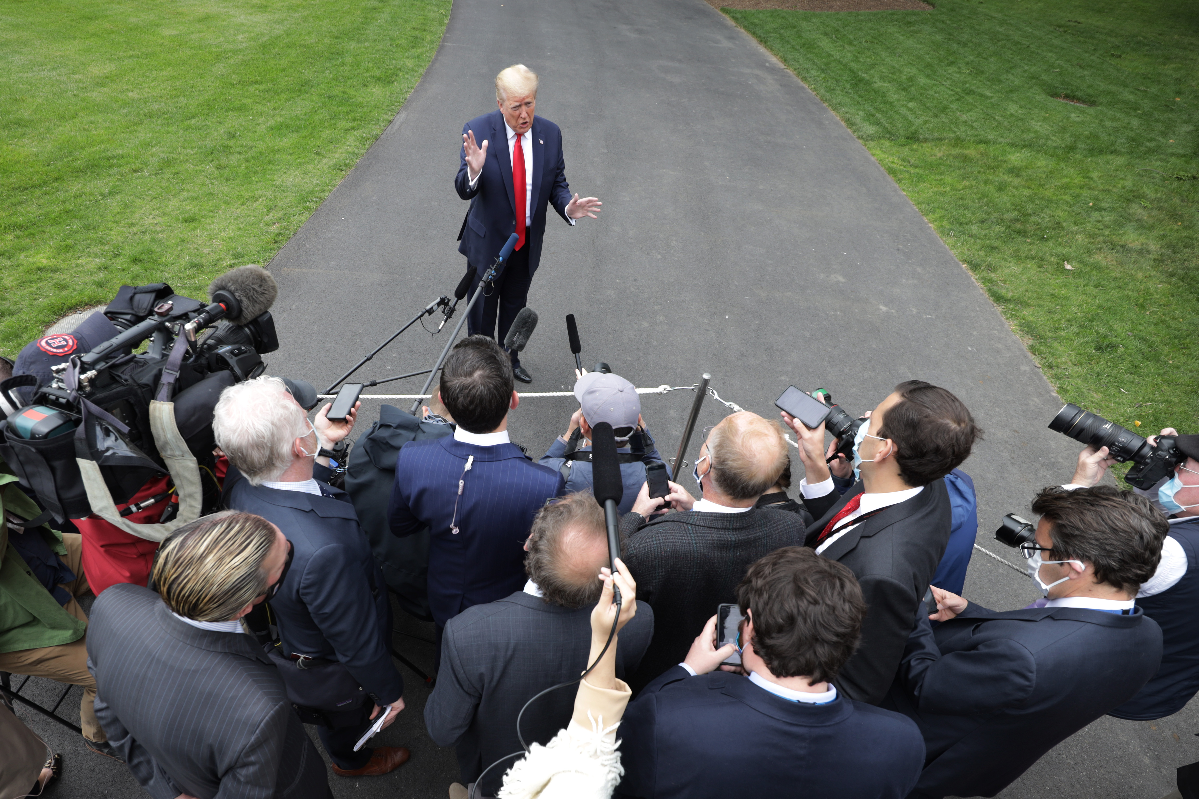 WASHINGTON, DC - MAY 21: U.S. President Donald Trump speaks to the press on the South Lawn of the White House prior to departing on Marine One May 21, 2020 in Washington, DC. President Trump is scheduled to visit a Ford manufacturing plant that is currently producing ventilators in Michigan. (Photo by Alex Wong/Getty Images)