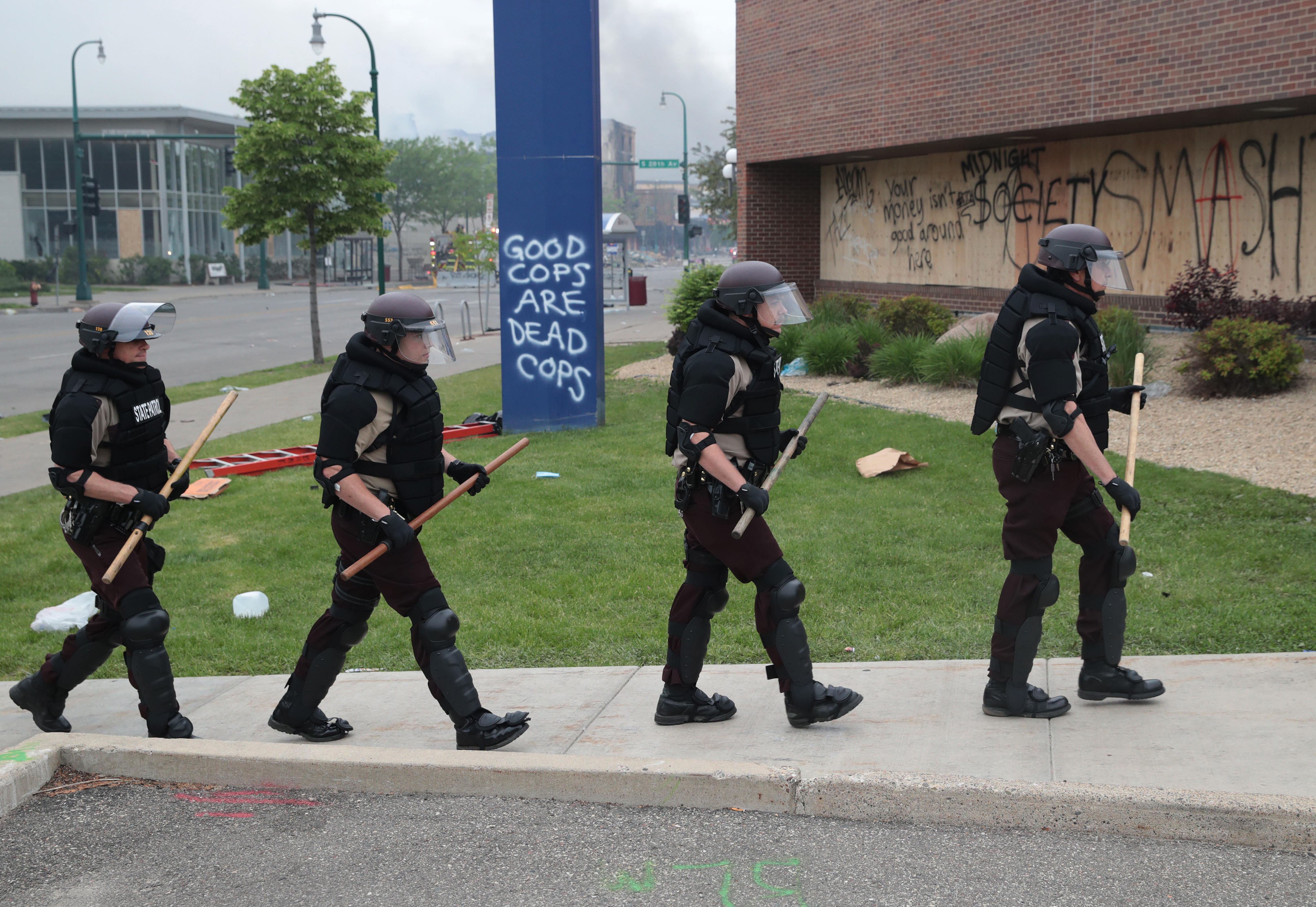 MINNEAPOLIS, MINNESOTA - MAY 29: Police carrying batons patrol on the fourth day of protests on May 29, 2020 in Minneapolis, Minnesota. The National Guard has been activated as protests continue after the death of George Floyd which has caused widespread destruction and fires across Minneapolis and St. Paul. (Photo by Scott Olson/Getty Images)