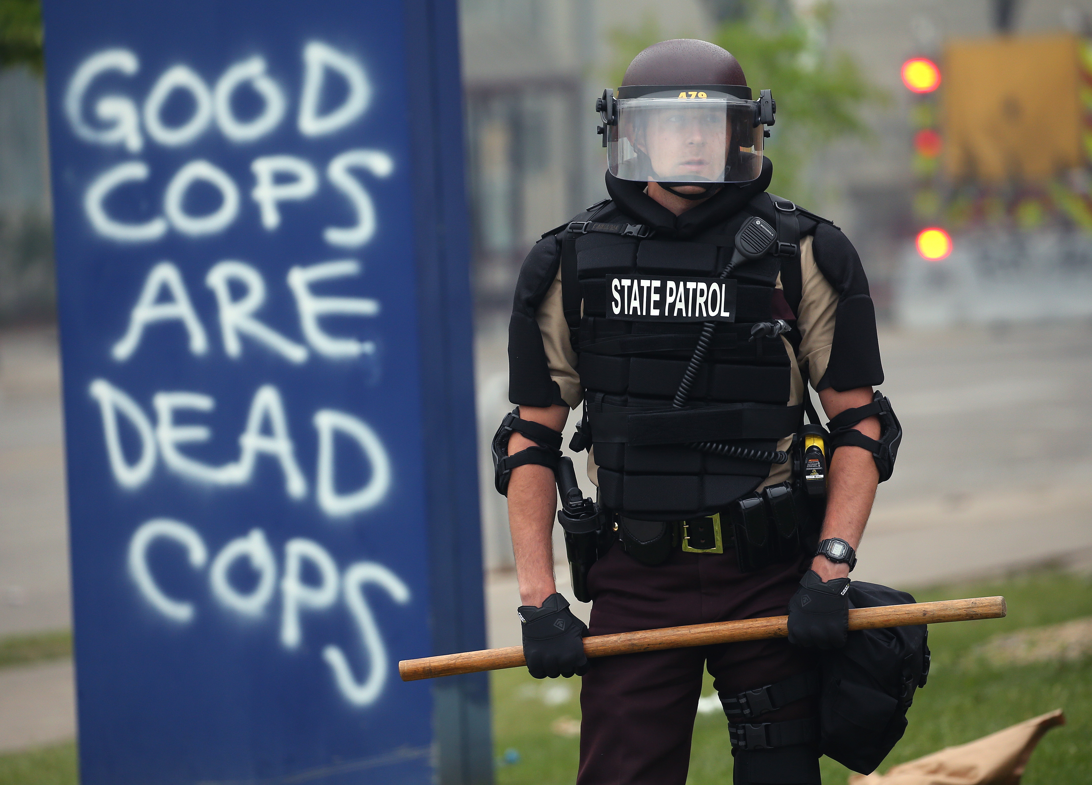 MINNEAPOLIS, MINNESOTA - MAY 29: A member of the State Patrol stands guard on the fourth day of protests on May 29, 2020 in Minneapolis, Minnesota. The National Guard has been activated as protests continue after the death of George Floyd which has caused widespread destruction and fires across Minneapolis and St. Paul. (Photo by Scott Olson/Getty Images)