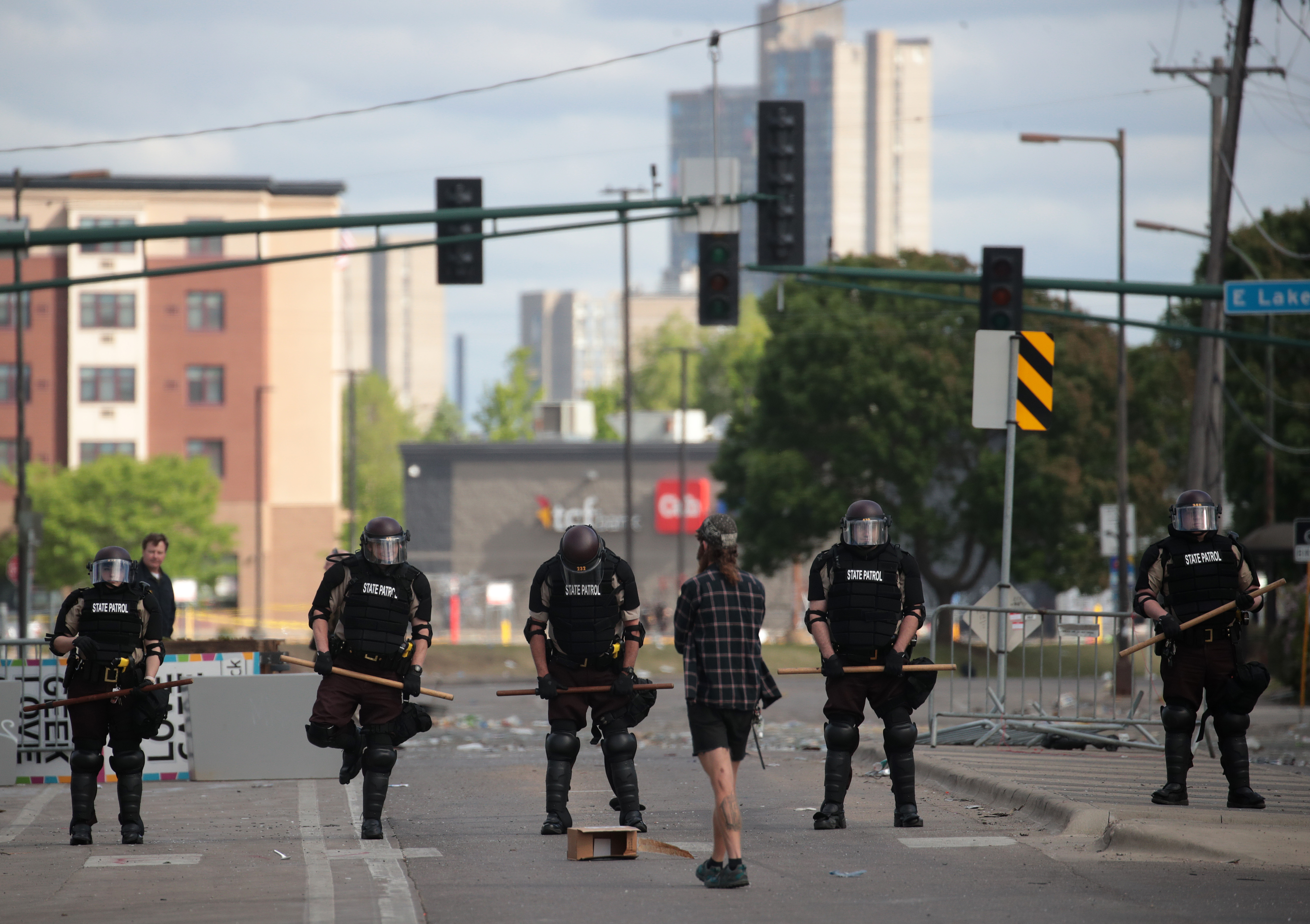 MINNEAPOLIS, MINNESOTA - MAY 29: A man approaches a police line after a night of protests and violence on May 29, 2020 in Minneapolis, Minnesota. The National Guard has been activated as protests continue after the death of George Floyd which has caused widespread destruction and fires across Minneapolis and St. Paul. (Photo by Scott Olson/Getty Images)