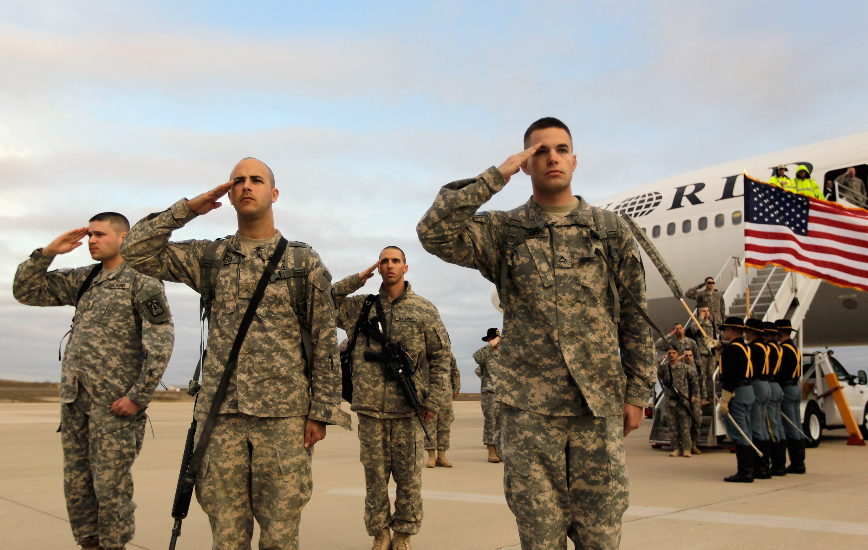 FORT HOOD, TX - DECEMBER 16: U.S. Army soldiers from the 2-82 Field Artillery, 3rd Brigade, 1st Cavalry Division, salute after walking off the plane as they arrive at their home base of Fort Hood, Texas after being part of one of the last American combat units to exit from Iraq on December 16, 2011 in Fort Hood, Texas. The U.S. military formally ended its mission in Iraq after eight years of war and the overthrow of Saddam Hussein. (Photo by Joe Raedle/Getty Images)