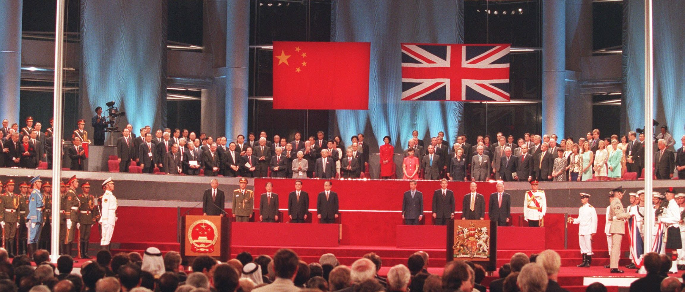 A general view of the handover ceremony 01 July showing the Chinese flag (L) flying after the Union Jack was lowered. AFP PHOTO/ POOL/Kimimasa MAYAMA (Photo credit should read KIMIMASA MAYAMA/AFP via Getty Images)