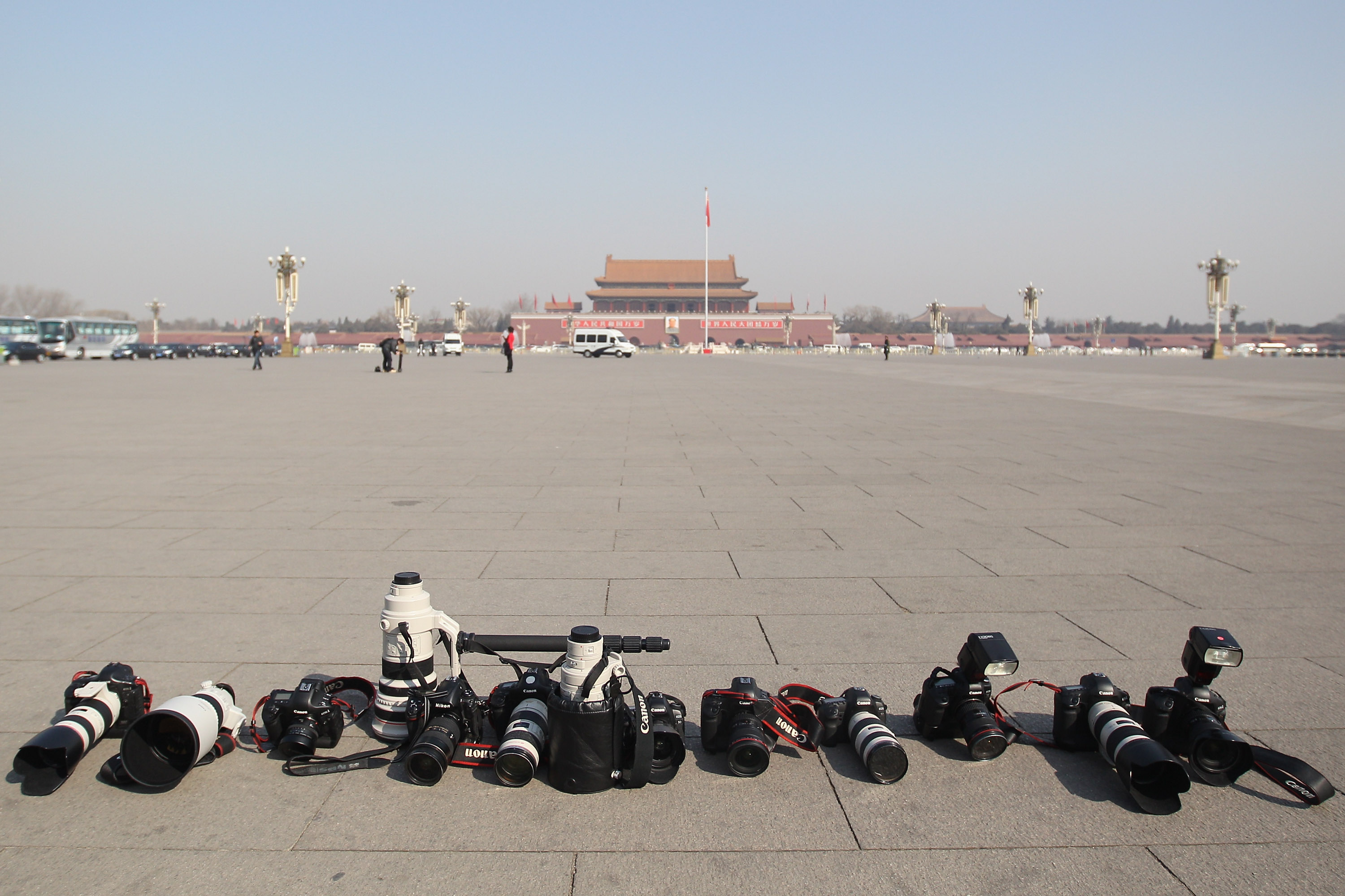 A general view of the photojournalists' cameras and lenses at the Tian'anmen Square after the closing ceremony of the Chinese People's Political Consultative Conference (CPPCC) outside on March 13, 2012 in Beijing, China. (Photo by Feng Li/Getty Images)