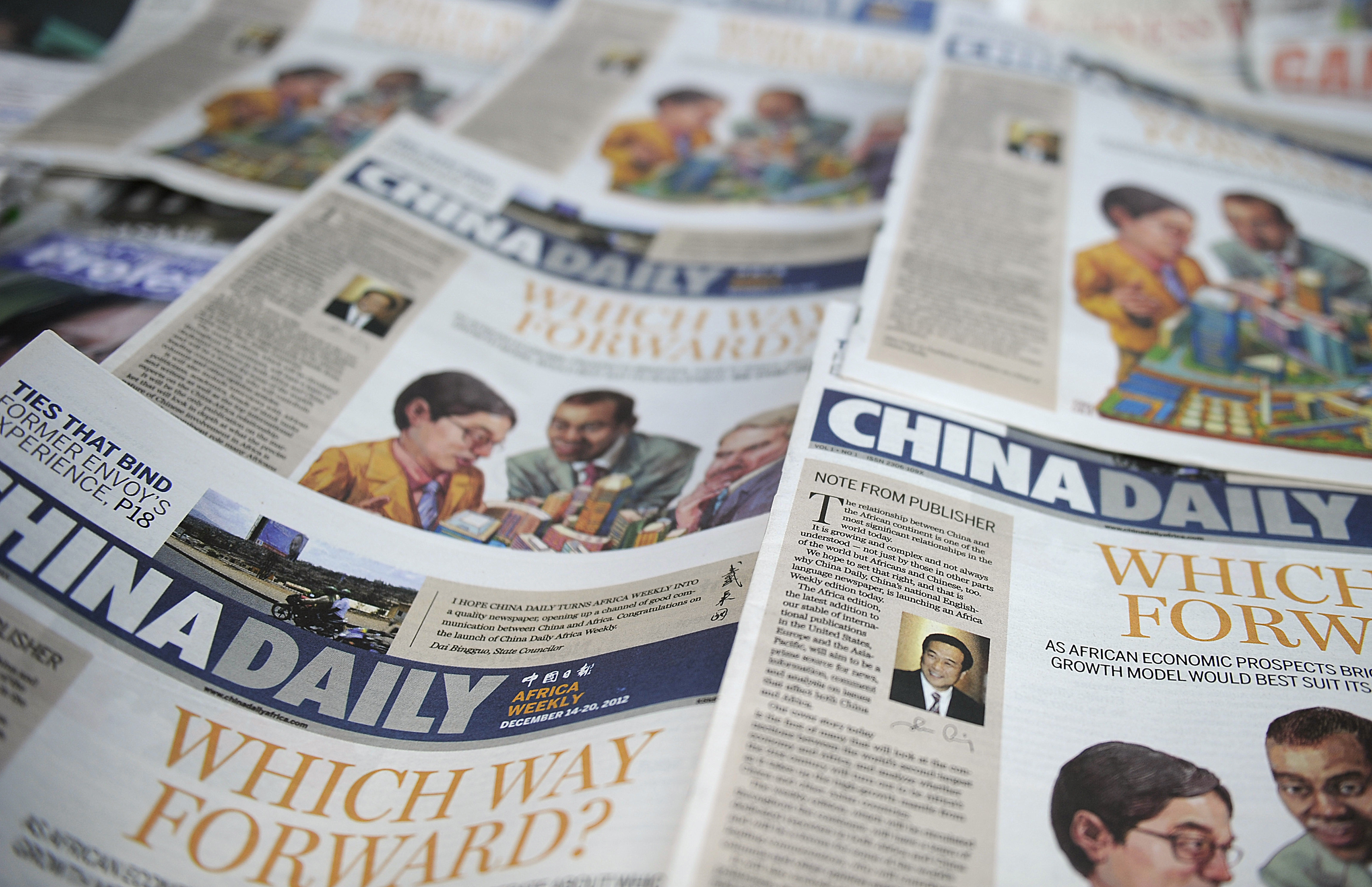 Copies of China's Africa edition of its daily newspaper sits on a news stand in the Kenyan capital Nairobi on December 14, 2012. (TONY KARUMBA/AFP via Getty Images)