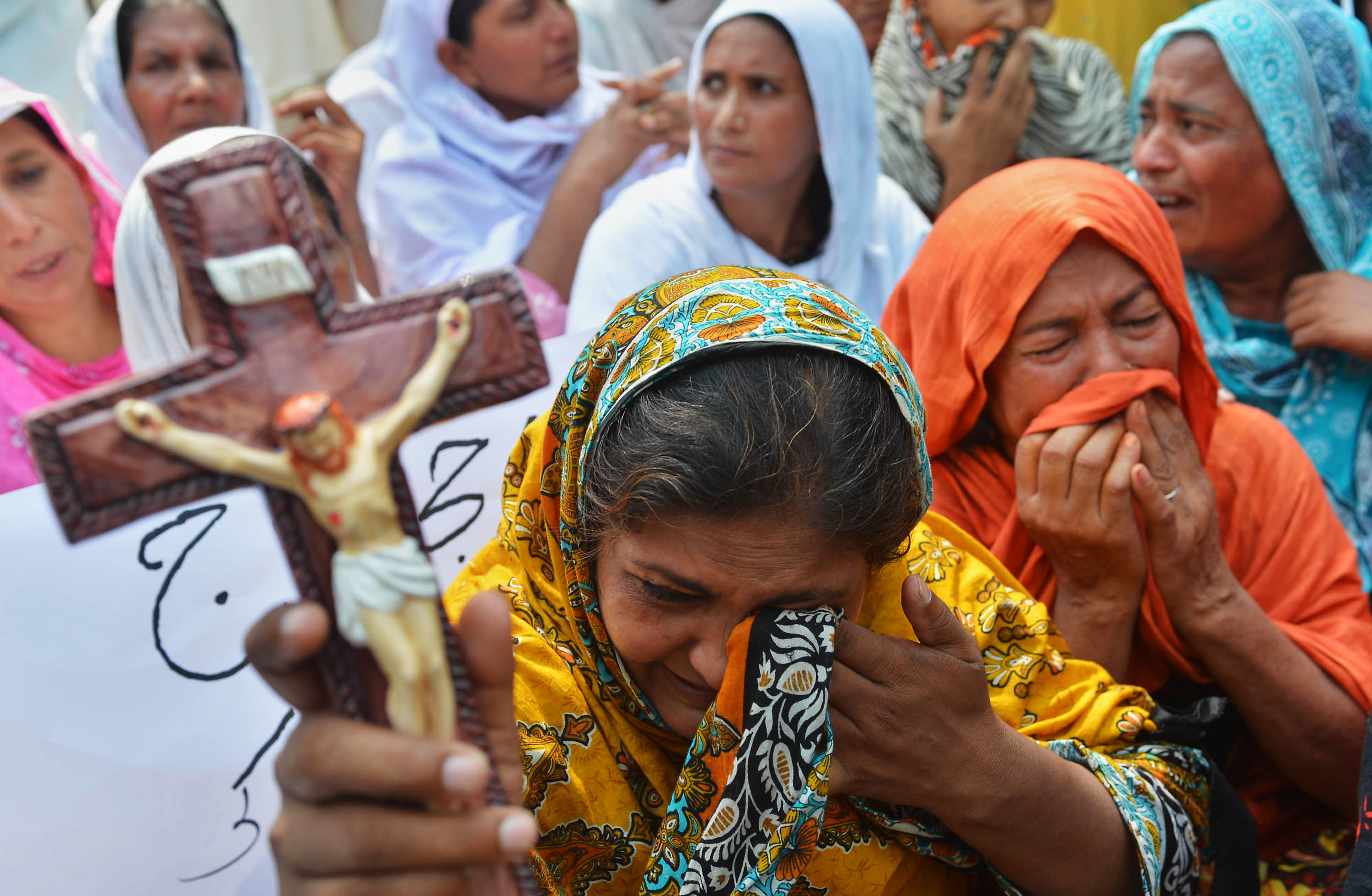 Pakistani Christians protest against the suicide bombing in All Saints church in the northwestern city of Peshawar on September 23, 2013. (A Majeed/AFP via Getty Images)