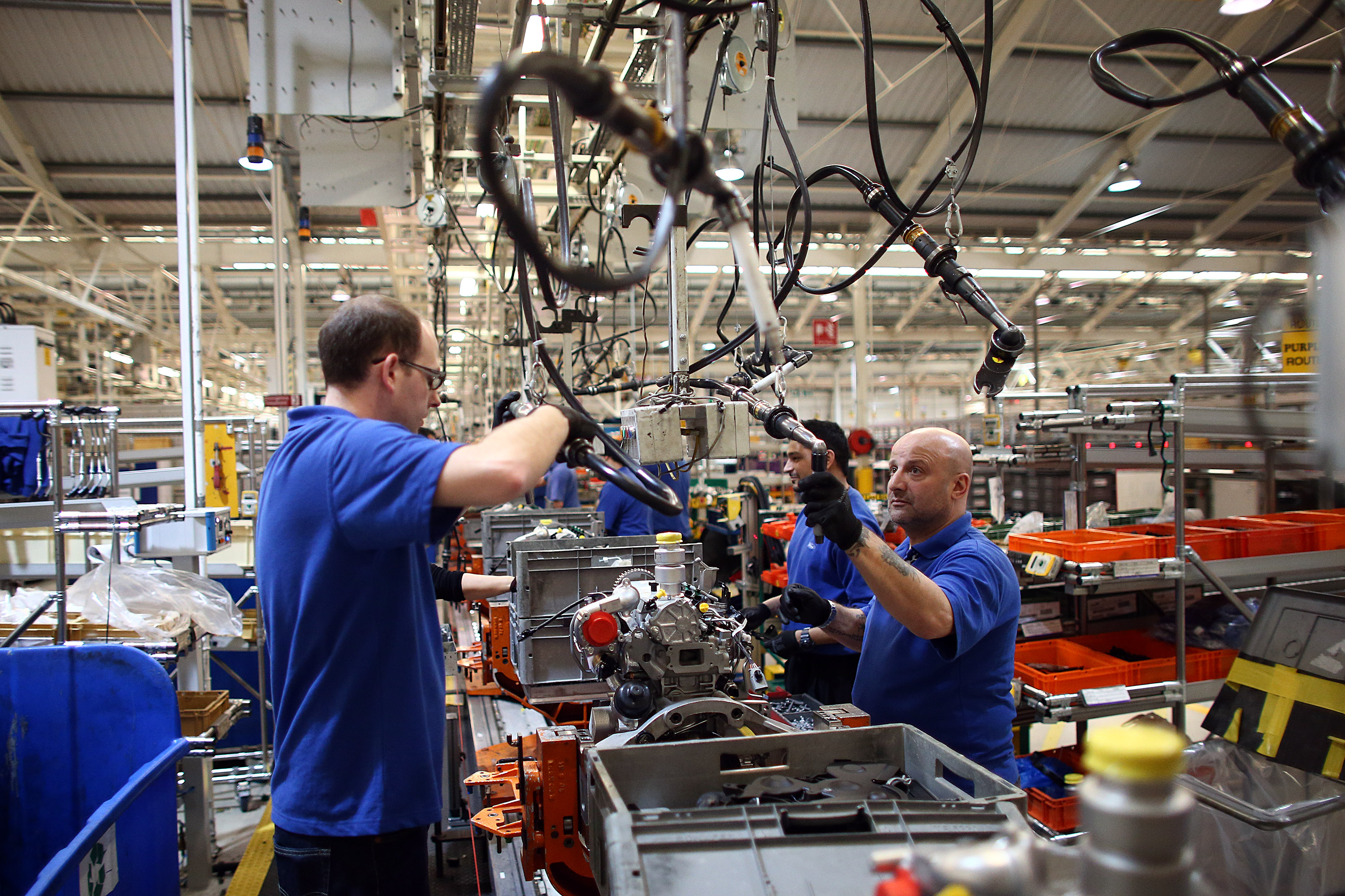 An employee works on an engine production line at a Ford factory on January 13, 2015 in Dagenham, England. Originally opened in 1931, the Ford factory has unveiled a state of the art GBP475 million production line that will start manufacturing the new low-emission, Ford diesel engines from this November this will generate more than 300 new jobs, Ford currently employs around 3000 at the plant in Dagenham. (Photo by Carl Court/Getty Images)