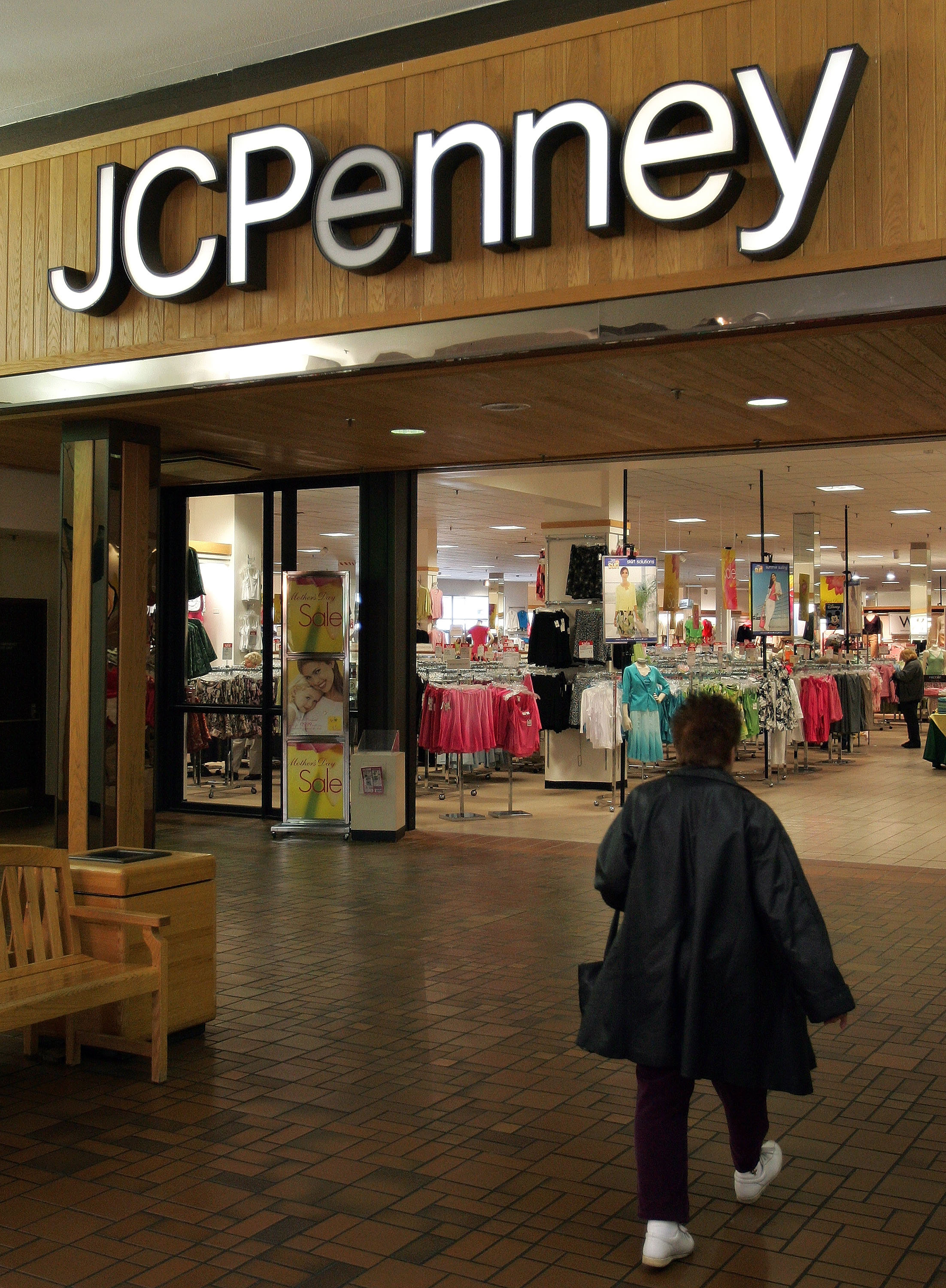 A woman walks toward the entrance of a JCPenney store May 3, 2005 in Niles, Illinois. (Photo by Tim Boyle/Getty Images)