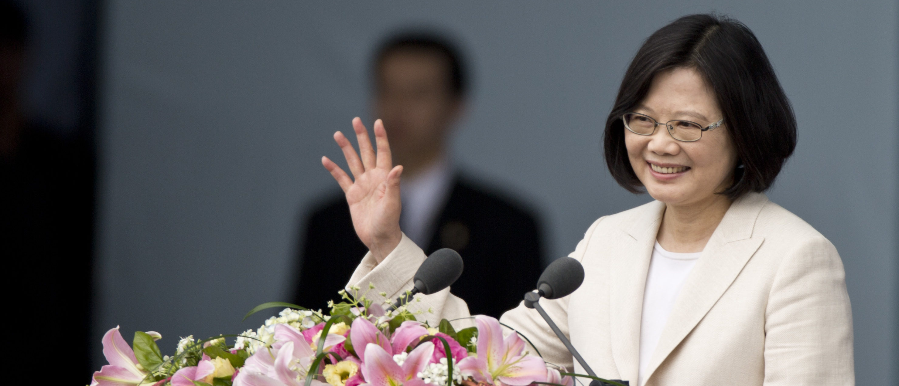 TAIPEI, TAIWAN - MAY 20: Taiwan President Tsai Ing-wen waves to the crowd on May 20, 2016 in Taipei, Taiwan. Taiwan's new president Tsai Ing-wen took oath of office on May 20 after a landslide election victory on January 16, 2016. (Photo by Ashley Pon/Getty Images)
