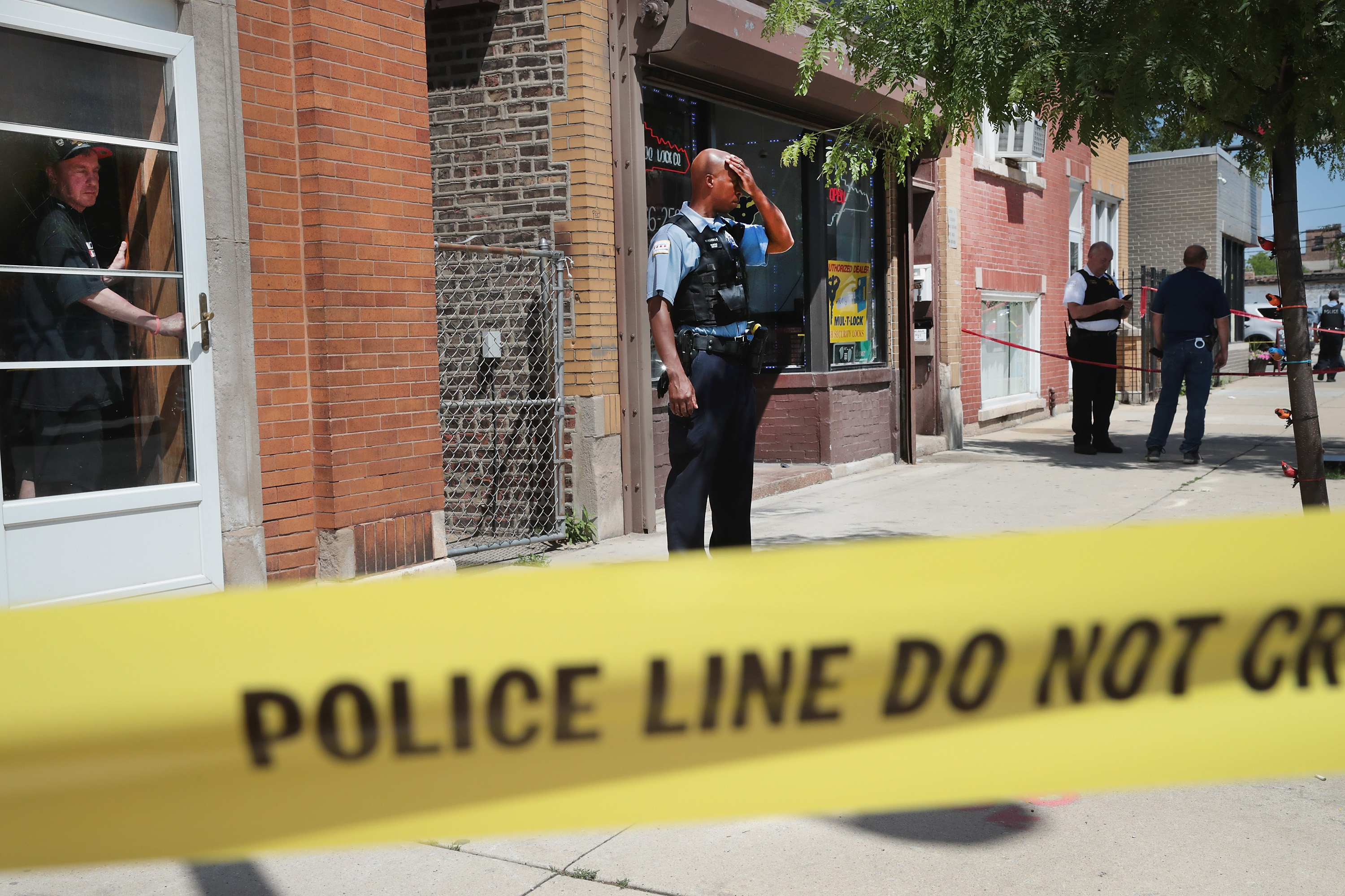 Police investigate a crime scene after two people were shot on the near Westside on June 15, 2016 in Chicago, Illinois. (Photo by Scott Olson/Getty Images)