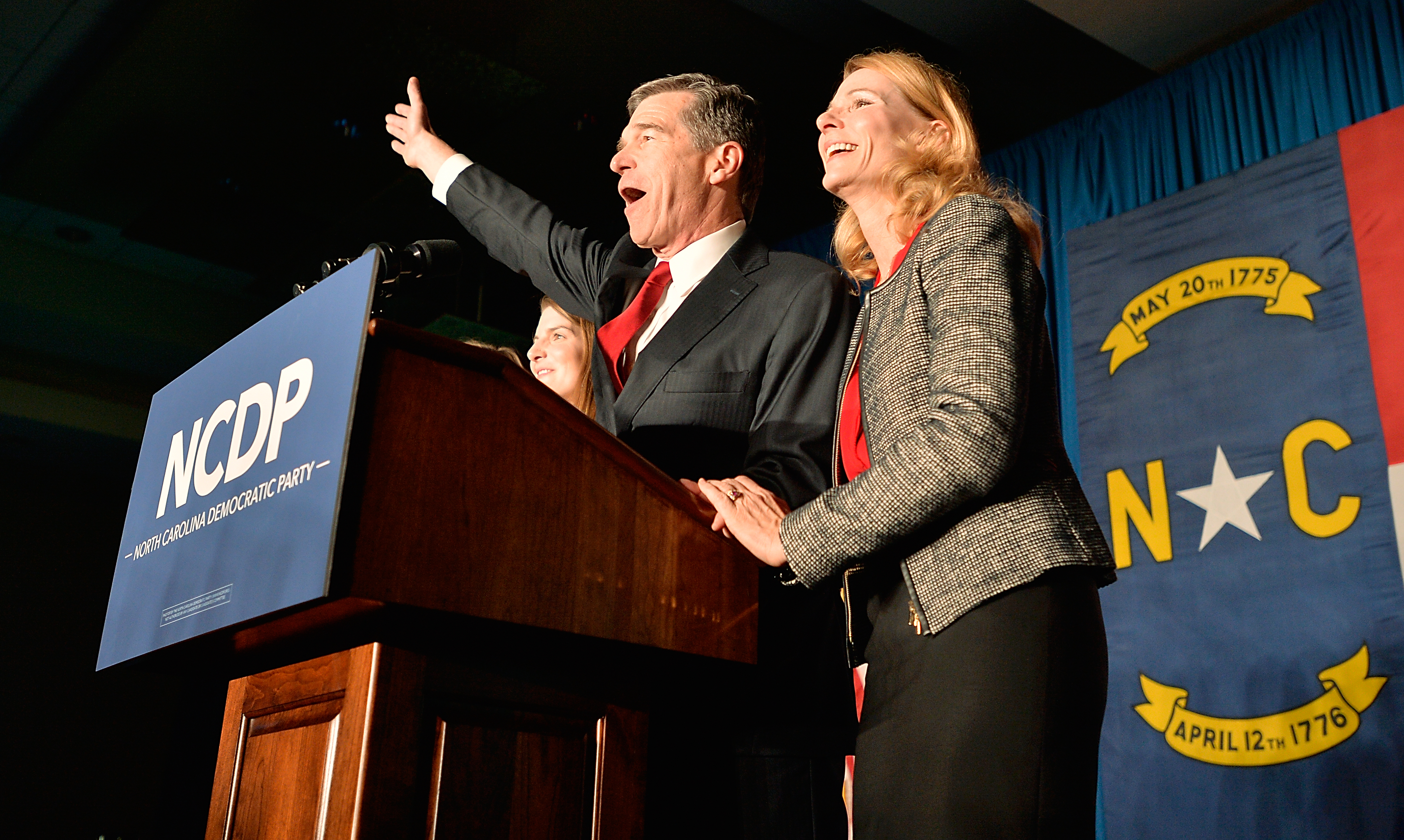 North Carolina Democratic presumptive Governor elect Roy Cooper waves to a crowd alongside his wife, Kristin Cooper, at the North Carolina Democratic Watch Party on November 9, 2016 in Raleigh, North Carolina. (Sara D. Davis/Getty Images)