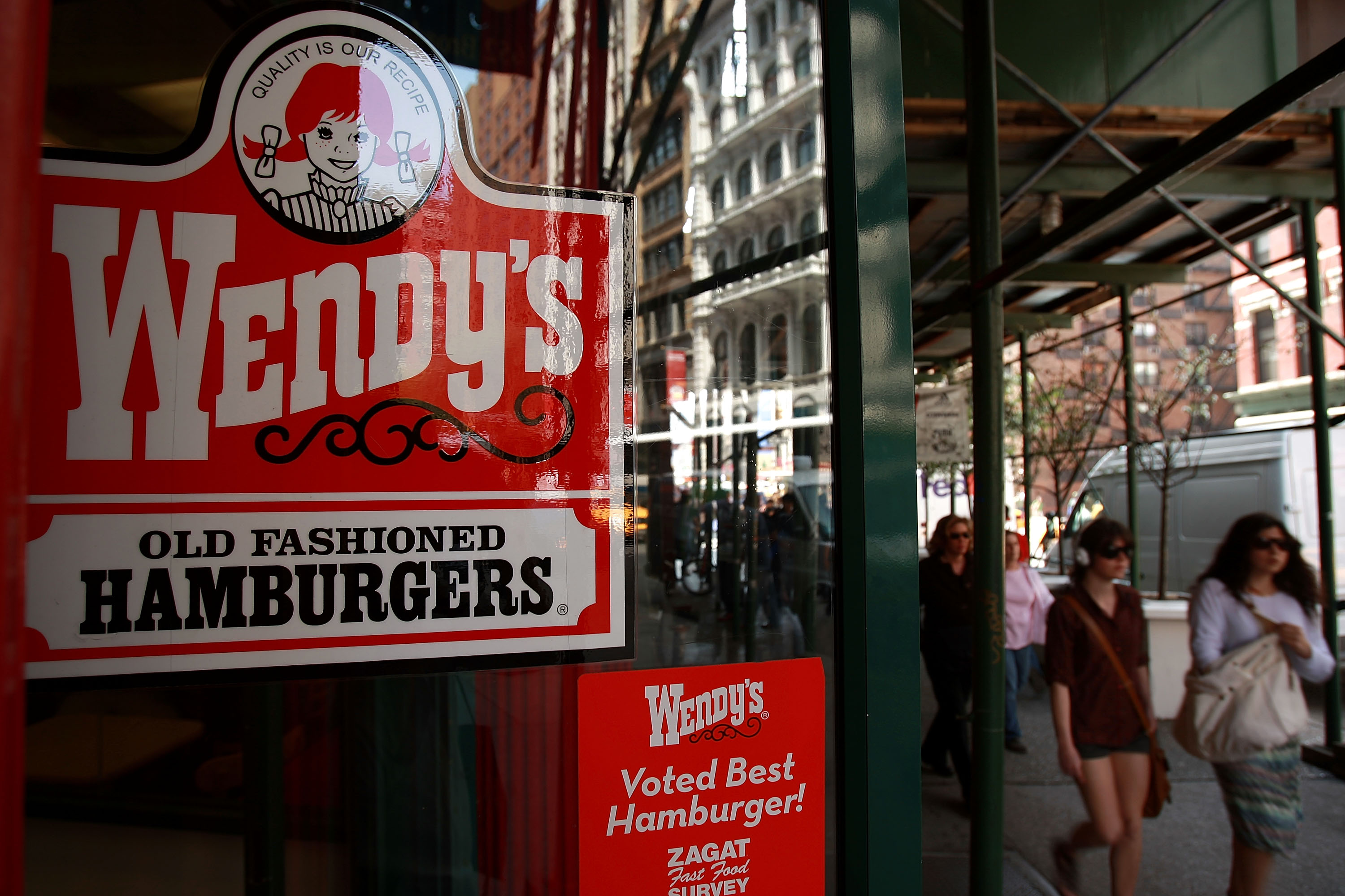 NEW YORK - APRIL 24: Pedestrians walk by a Wendy's hamburger chain April 24, 2008 in New York City. (Photo by Spencer Platt/Getty Images)