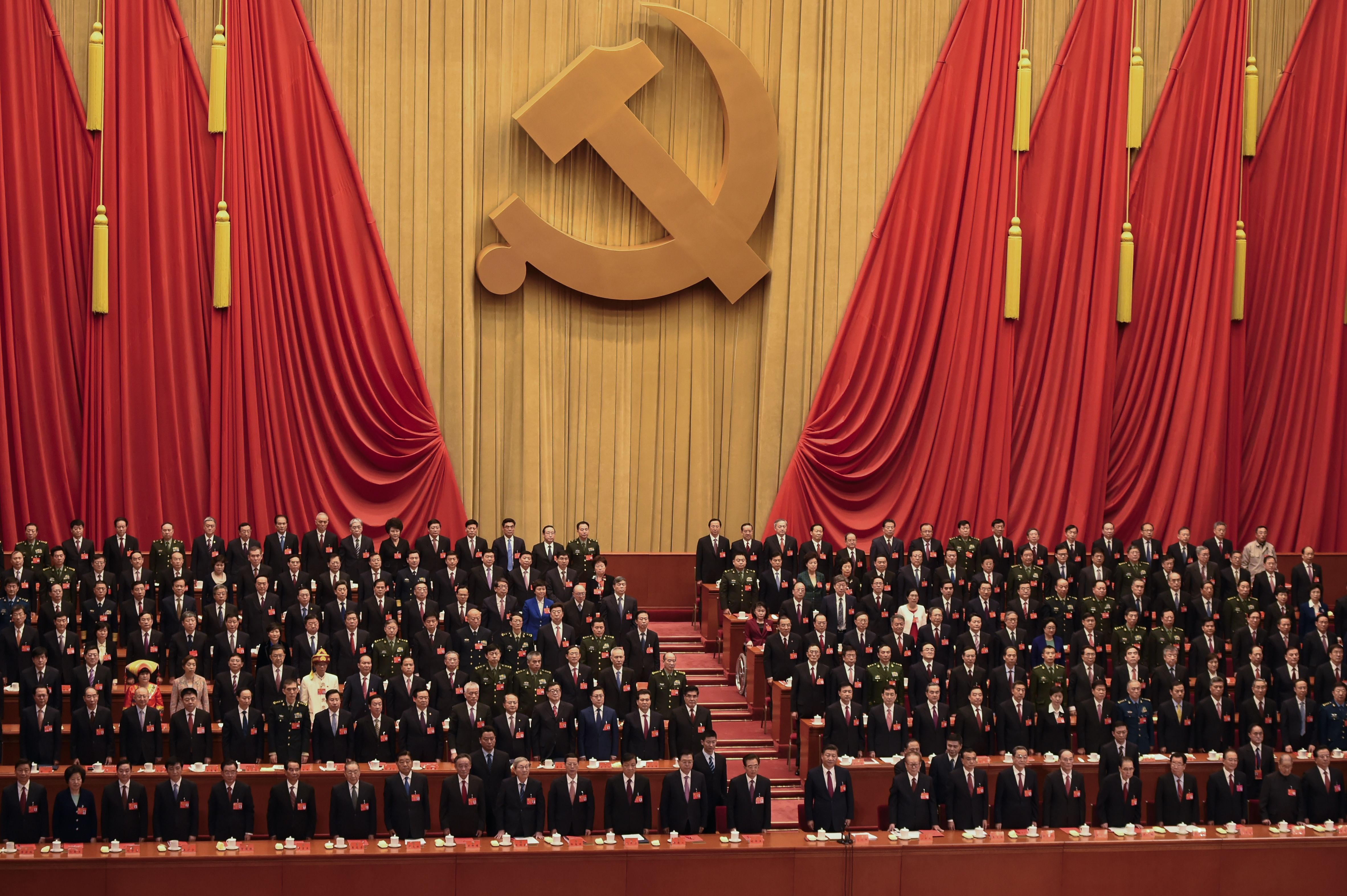 Delegates listen to the Internationale at the end of the closing session of the 19th Communist Party Congress at the Great Hall of the People in Beijing on October 24, 2017. (WANG ZHAO/AFP via Getty Images)