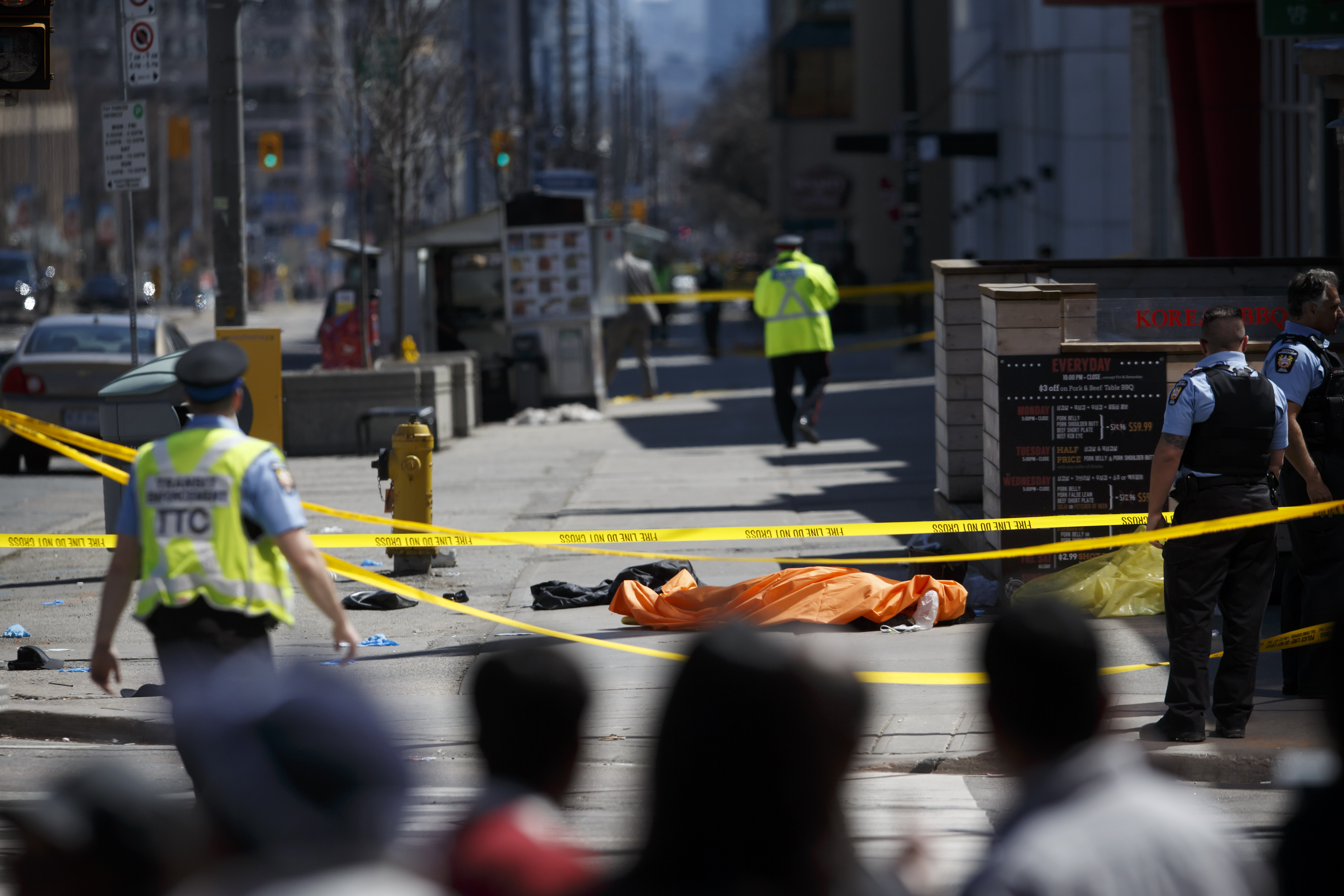 A tarp lays on top of a body on Yonge St. at Finch Ave. after a van plowed into pedestrians on April 23, 2018 in Toronto, Canada. (Photo by Cole Burston/Getty Images)