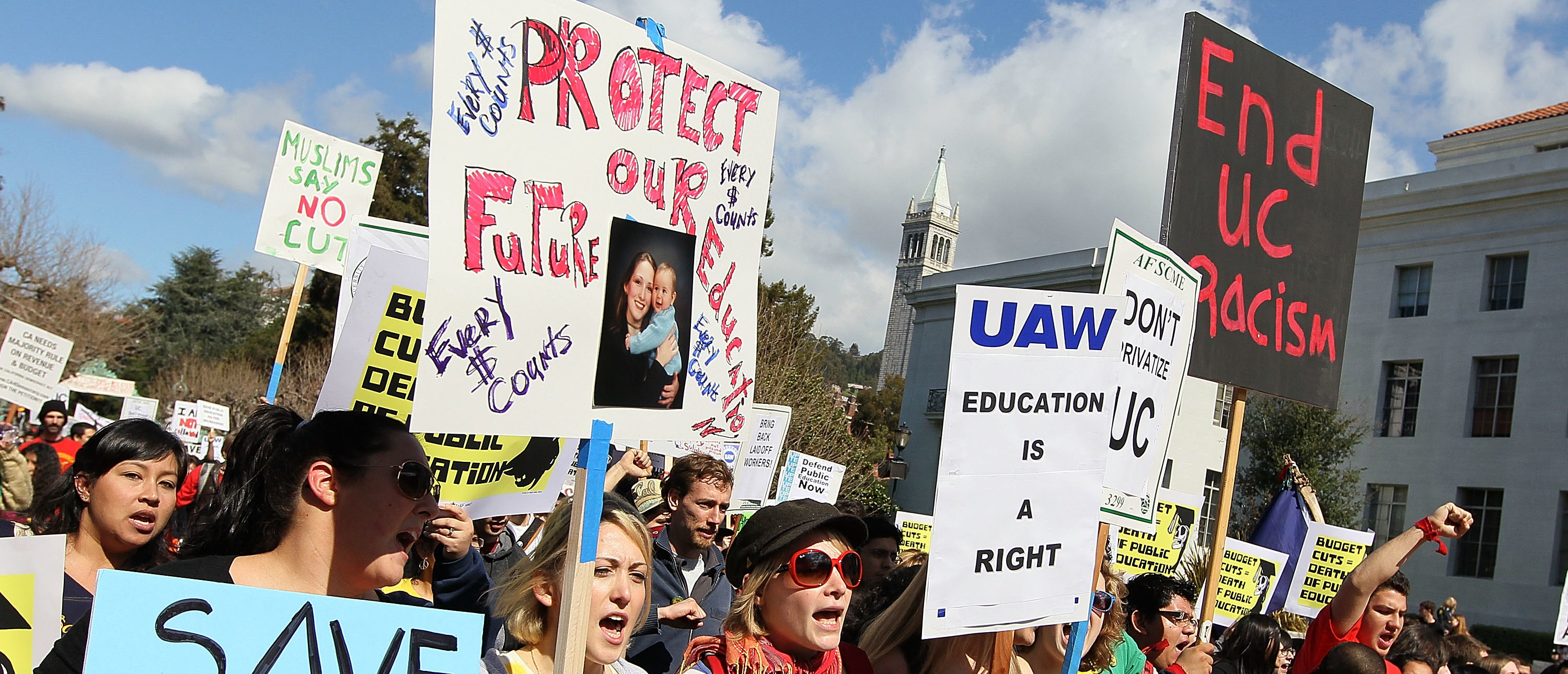 BERKELEY, CA - MARCH 04: Students at UC Berkeley carry signs as they march through campus during a national day of action against funding cuts and tuition increases March 4, 2010 in Berkeley, California. Students across the country are walking out of classes and holding demonstrations against massive tuition increases and funding cuts to college universities. (Photo by Justin Sullivan/Getty Images)