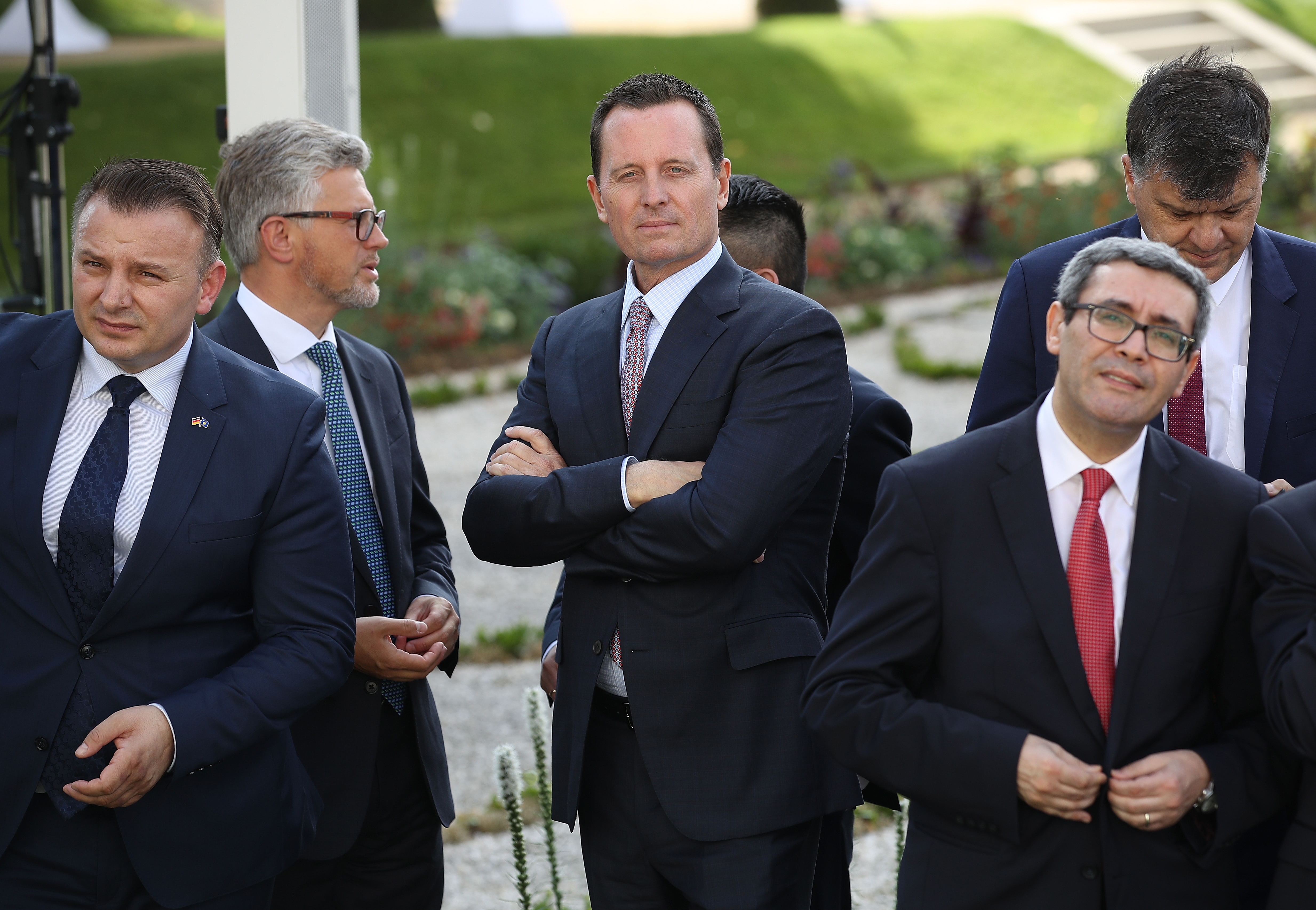 GRANSEE, GERMANY - JULY 06: U.S. Ambassador Richard Grenell (C) attends a reception for the internaitonal diplomatic corps hosted by German Chancellor Angela Merkel at Schloss Meseberg palace on July 6, 2018 near Gransee, Germany. Grenell, who was appointed ambassador by U.S. President Donald Trump, recently met with German auto executives to propose a cancelleation of tariffs on cars by both the U.S. and Germany. (Photo by Sean Gallup/Getty Images)