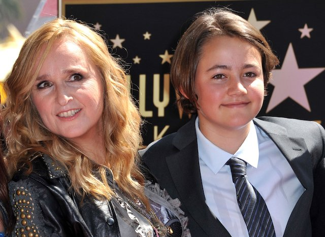 This photo taken on September 27, 2011 shows singer Melissa Etheridge posing with her son Beckett during her Walk of Fame ceremony held at the Hard Rock cafe in Hollywood. - Beckett Cypher, the singer's son with former partner Julie Cypher, has died at the age of 21. A Tweet sent on May 13, 2020 from Melissa Etheridge's official account reads: