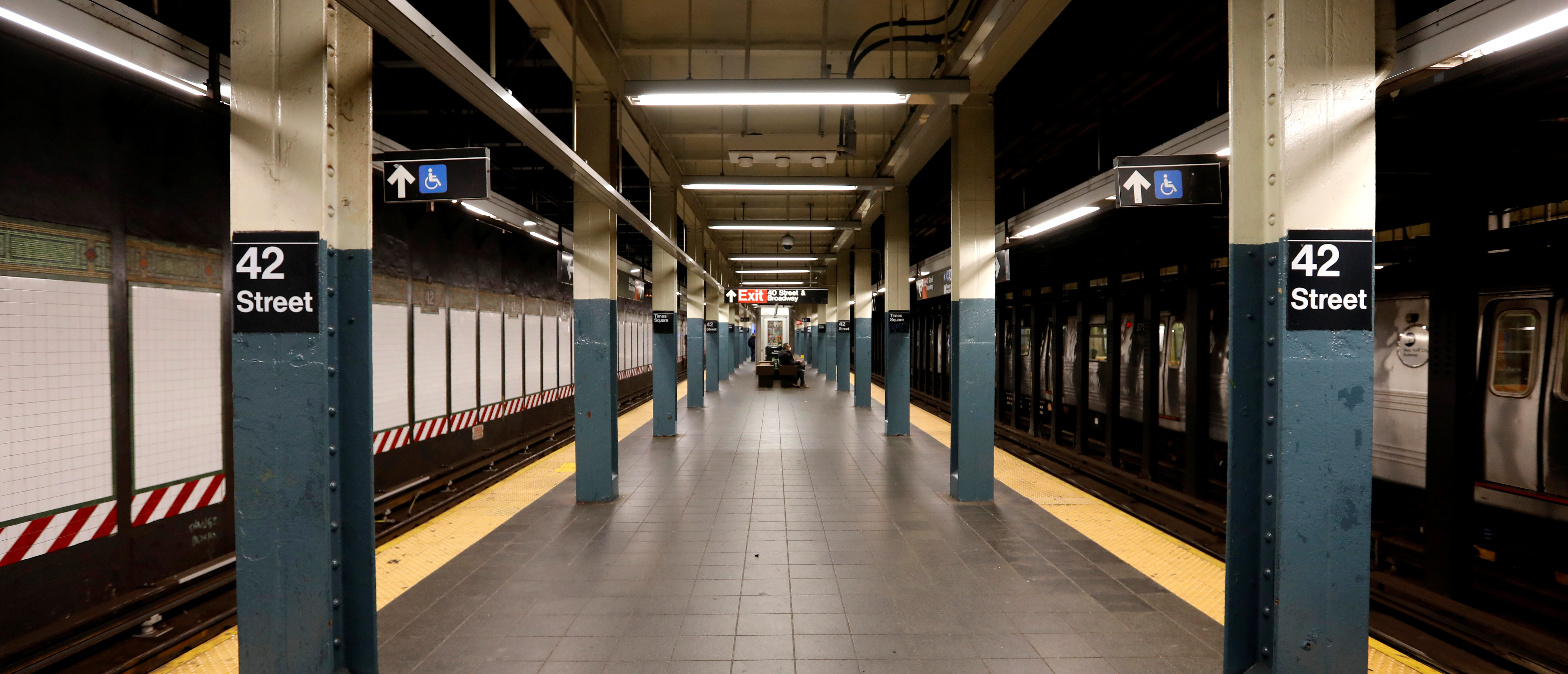 A nearly empty subway platform is seen at the 42nd Street subway station during the coronavirus outbreak in New York City, New York, U.S., March 20, 2020. REUTERS/Mike Segar