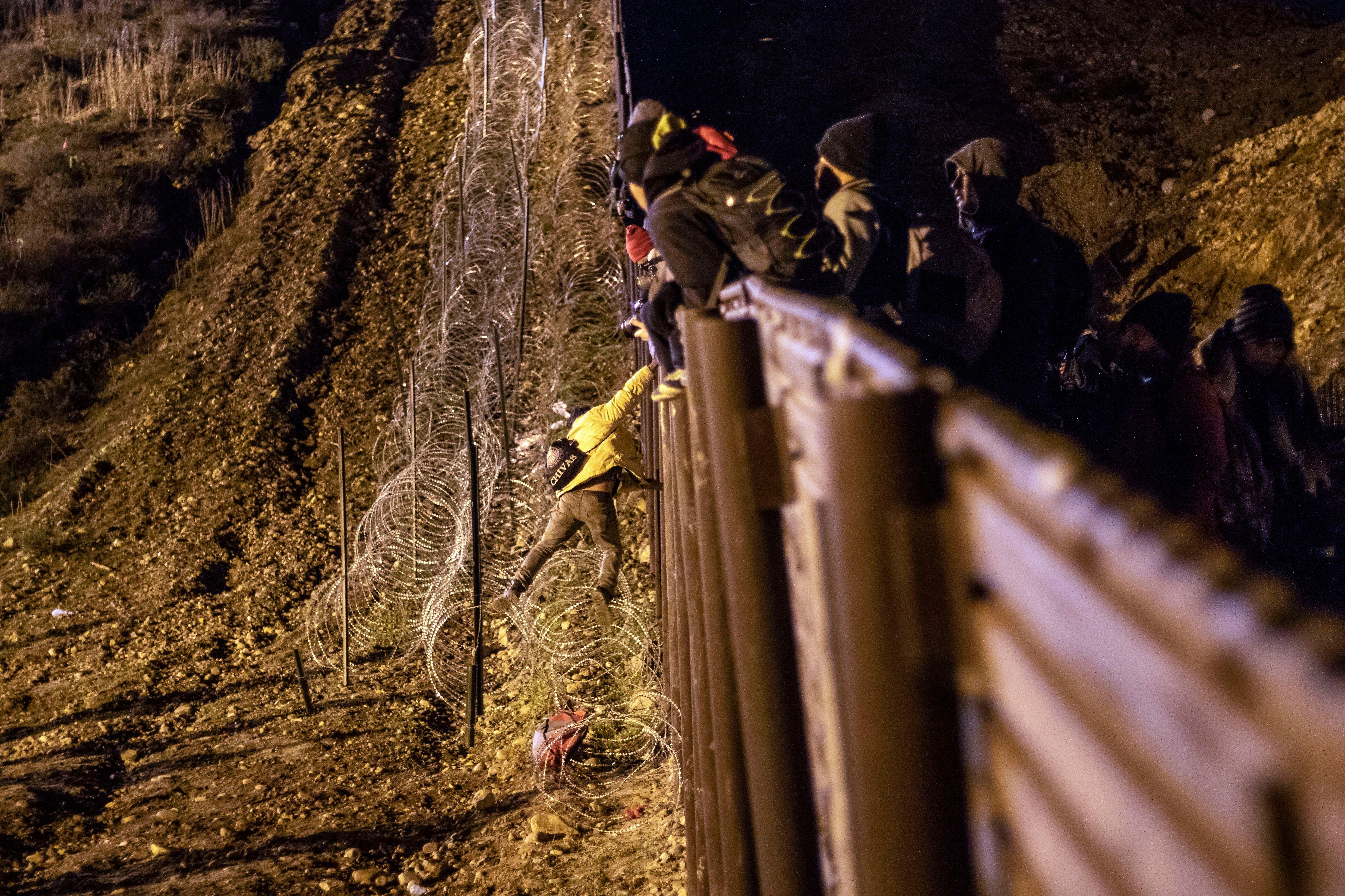 TOPSHOT-MEXICO-HONDURAS-US-MIGRATION (GUILLERMO ARIAS/AFP via Getty Images