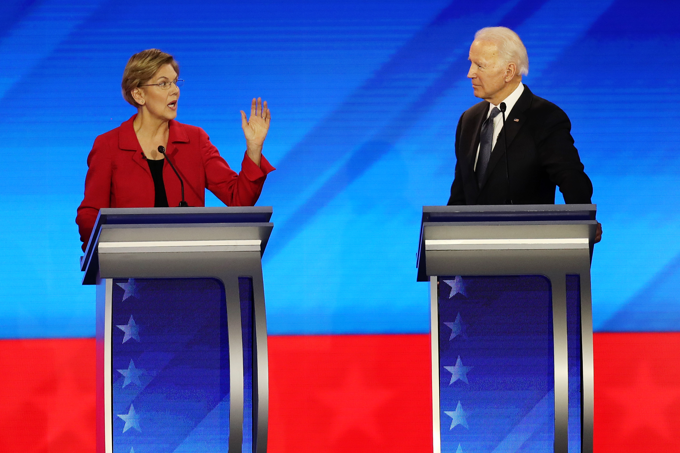 Democratic presidential candidates Sen. Elizabeth Warren (D-MA) and former Vice President Joe Biden participate in the Democratic presidential primary debate in the Sullivan Arena at St. Anselm College on February 07, 2020 in Manchester, New Hampshire. (Joe Raedle/Getty Images)