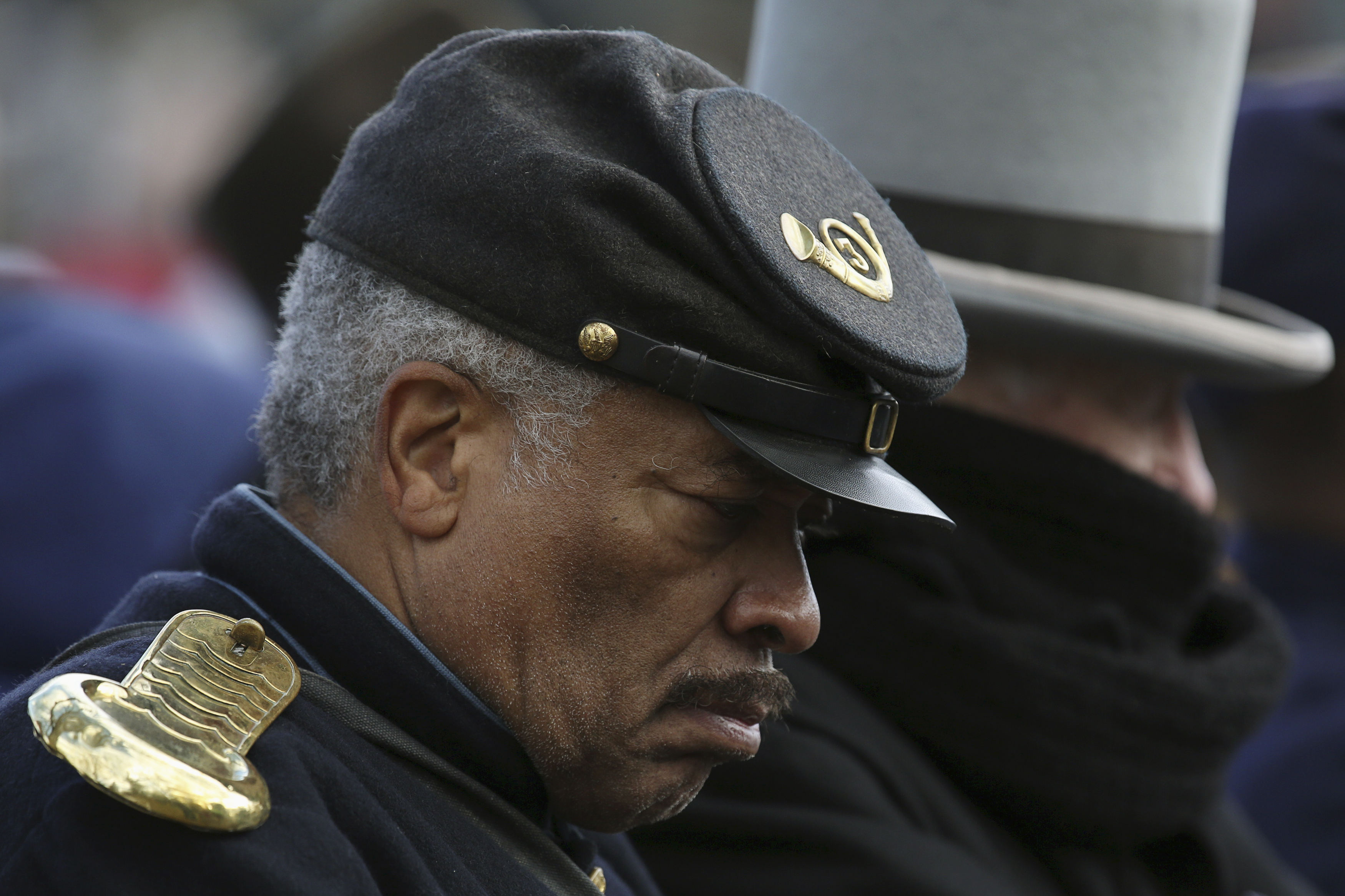 A re-enactor, portraying a member of the U.S. Colored Troops, a black regiment of African-American soldiers during the U.S. Civil War, listens to speeches at the Gettysburg National Cemetery in Pennsylvania November 19, 2013. U.S. President Abraham Lincoln travelled to in 1863 to deliver a few concluding remarks at a formal dedication at the cemetery. Today marks the 150th anniversary of Lincoln's famous two-minute speech, the Gettysburg Address. REUTERS/Gary Cameron