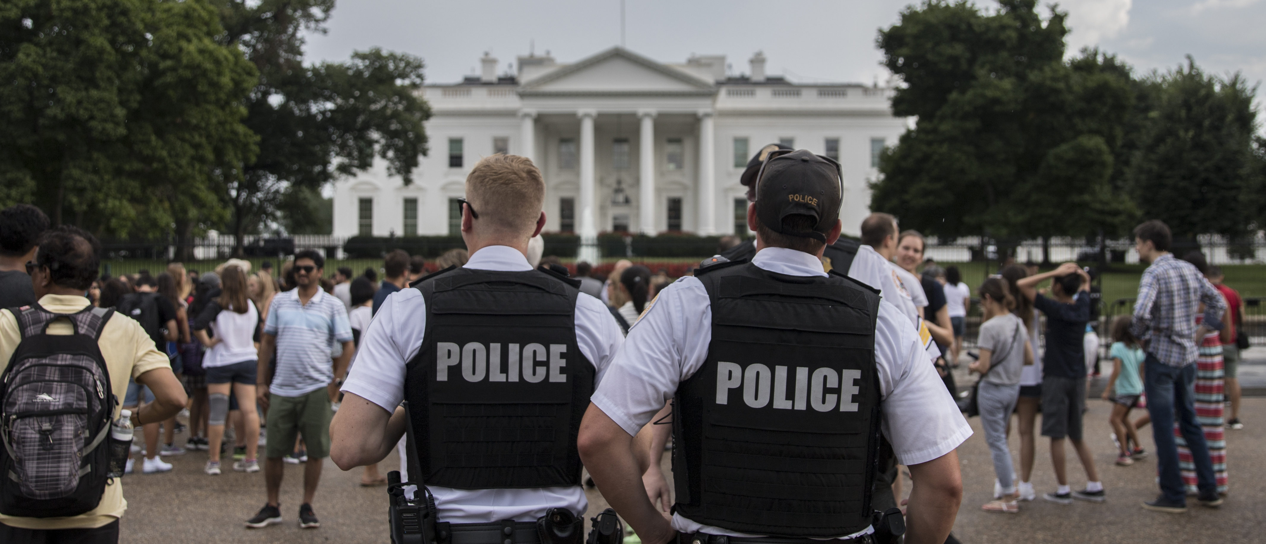 WASHINGTON, DC - AUGUST 11: Police patrol outside the White House on August 11, 2018 in Washington, DC. A 'Unite the Right' rally featuring white supremacist forces and counter protesters is planned for tomorrow in Washington, DC. (Photo by Alex Wroblewski/Getty Images)
