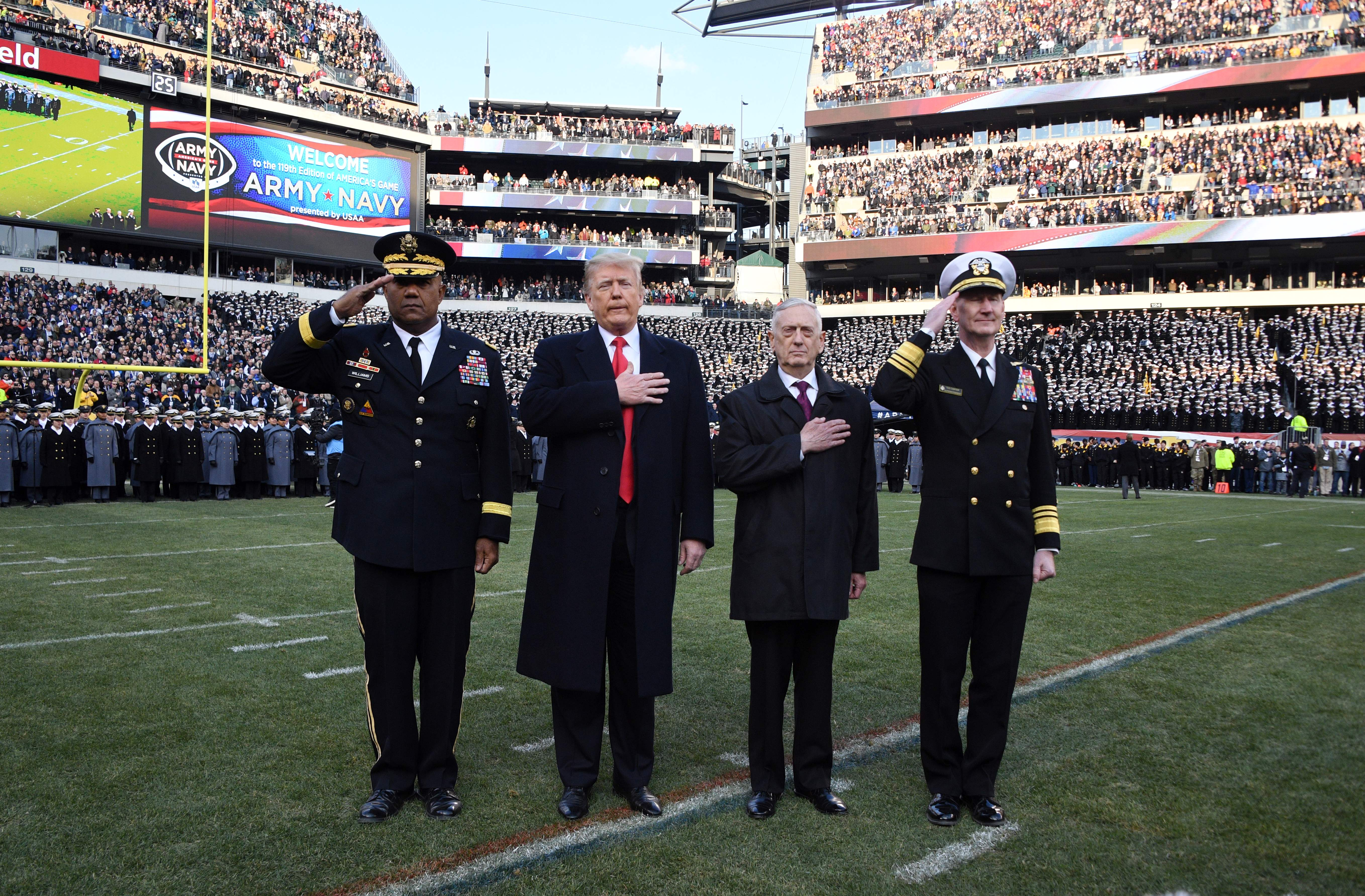 US President Donald Trump (2nd-L) and US Defense Secretary Jim Mattis (2nd-R) attend the annual Army-Navy football game at Lincoln Financial Field in Philadelphia, Pennsylvania, December 8, 2018. - Trump will officiate the coin toss at Lincoln Financial Field in Philadelphia between the Army Black Knights of the US Military Academy (USMA) and the Navy Midshipmen of the US Naval Academy (USNA). (Photo by Jim WATSON / AFP) (JIM WATSON/AFP via Getty Images)