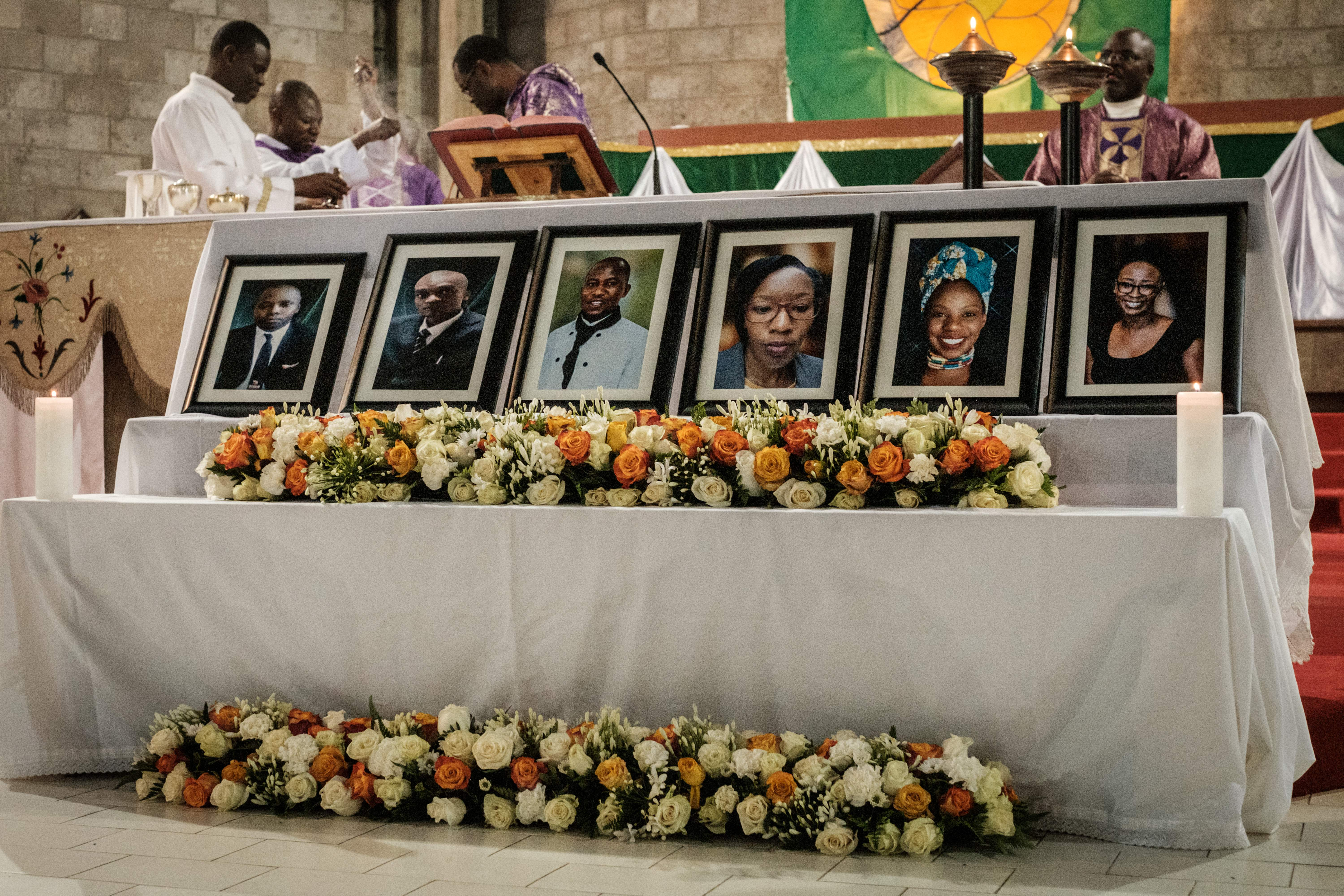 A priest celebrates the memorial service, on January 23, 2019, at the Consolata Shrine in Nairobi for six staff members of the Dusit hotel and office complex who were found dead following an attack where least 21 people were killed in a terror attack claimed by the Al-Qaeda-linked Somali group Al-Shabaab on the Dusit hotel complex in Nairobi on January 15. (YASUYOSHI CHIBA/AFP via Getty Images)