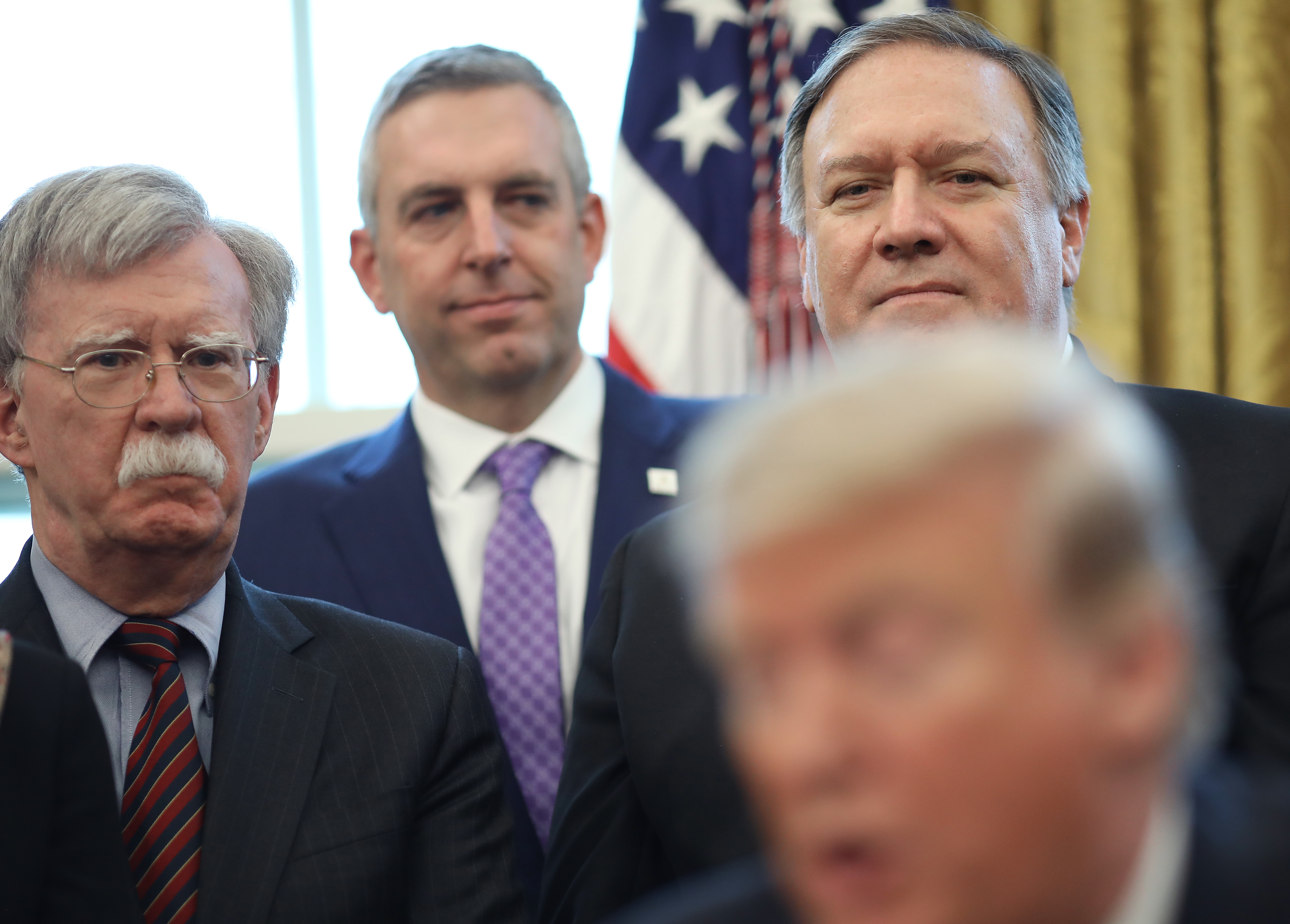 "WASHINGTON, DC - FEBRUARY 07: U.S. National Security Advisor John Bolton (L) and Secretary of State Mike Pompeo (R) listen as U.S. President Donald Trump speaks before signing a National Security Presidential Memorandum in the Oval Office February 7, 2019 in Washington, DC. The memorandum launches a Trump administration goal, the ""Women's Global Development and Prosperity"" Initiative, an initiative led by his daughter, Ivanka Trump. (Photo by Win McNamee/Getty Images)"