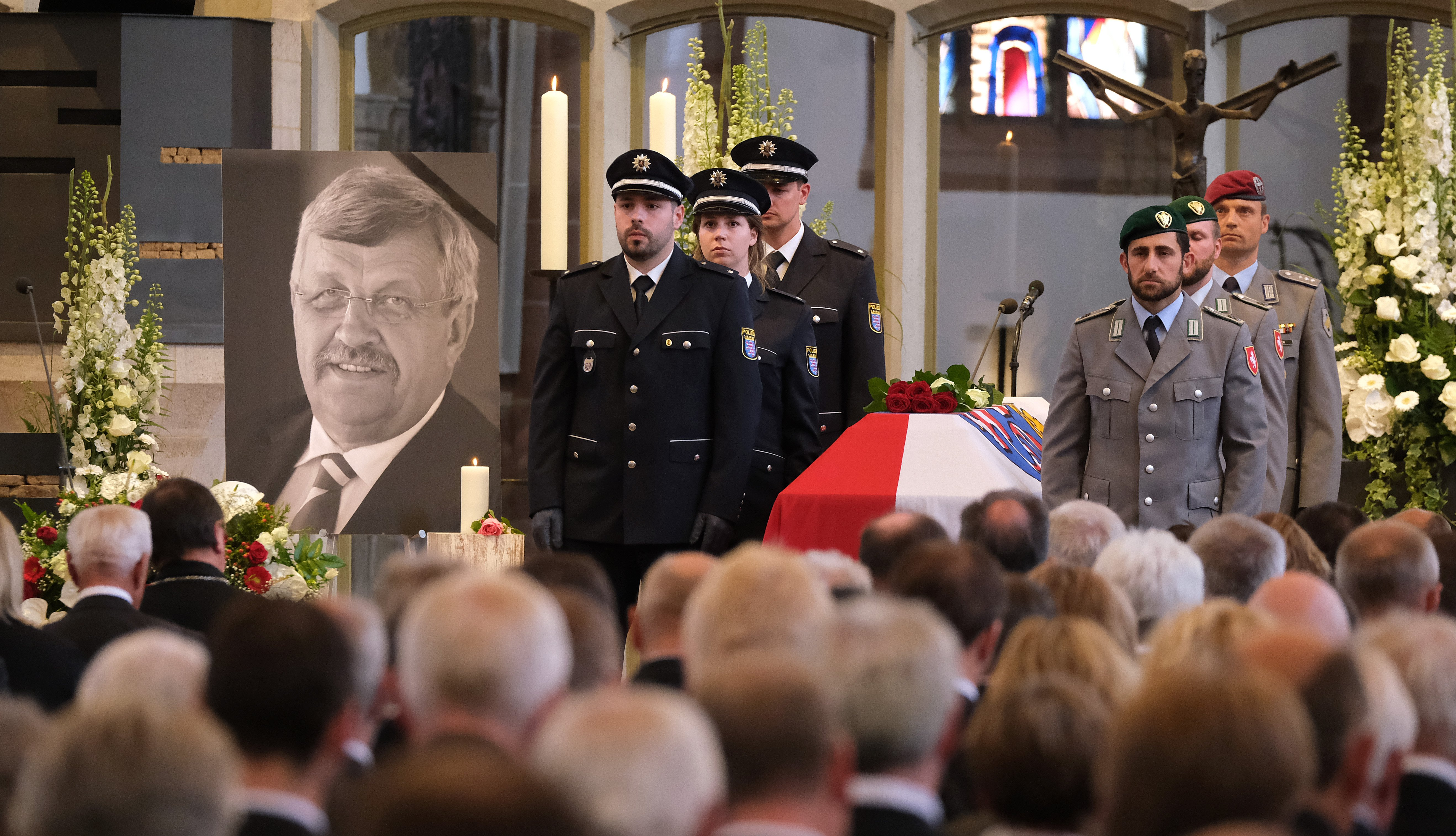An honor guard stands at the coffin of murdered German politician Walter Lübcke at his memorial service at St. Martin church on June 13, 2019 in Kassel, Germany. Lübcke was found dead, shot in the head at close range, on the terrace of his home on June 2. Investigators have ruled out suicide and are investigating the case as murder. Lübcke, a Christian Democrat (CDU), was outspoken in his pro-immigration views, and one possibility investigators are pursuing is a right-wing motive to the shooting. (Photo by Sean Gallup/Getty Images)