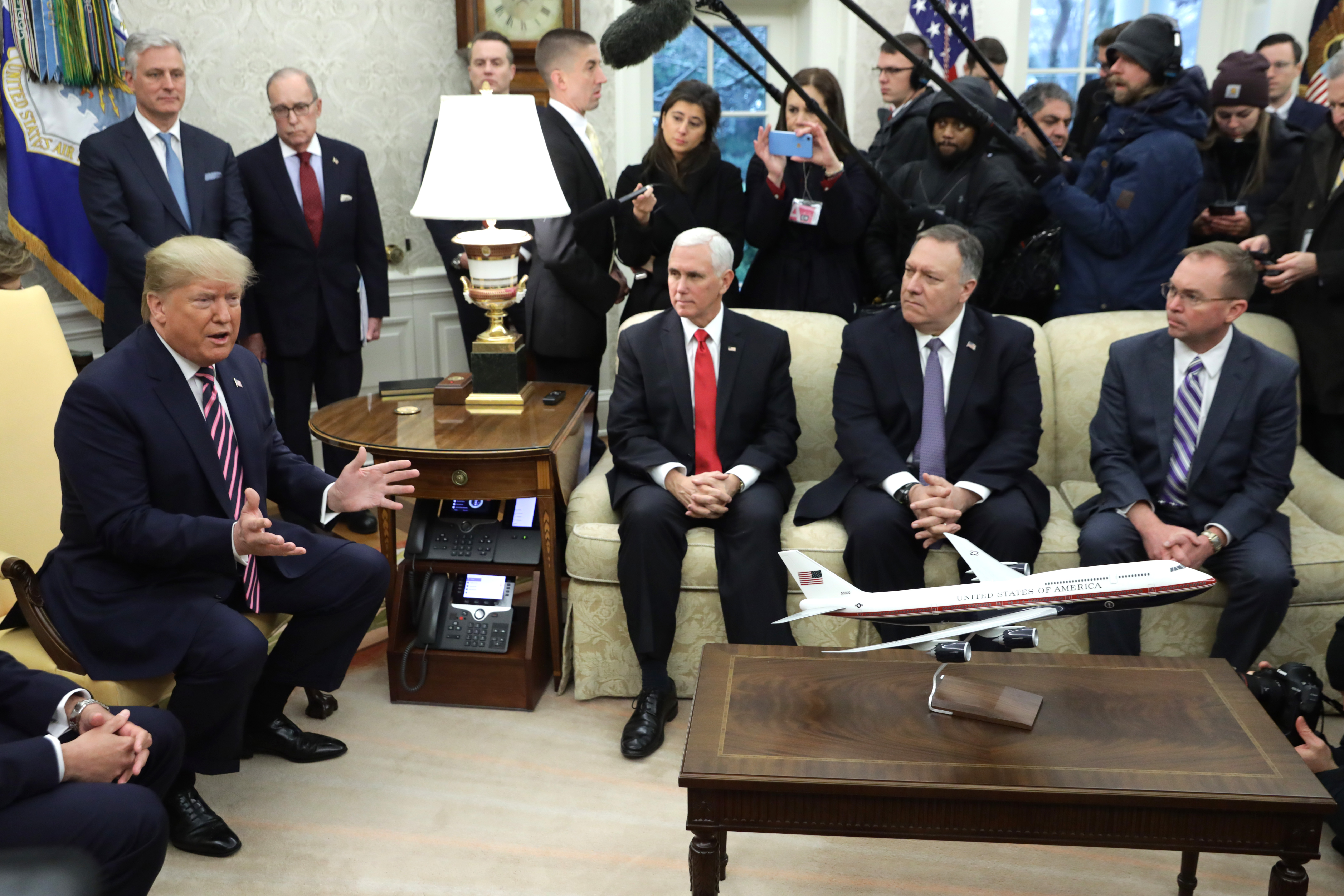 """WASHINGTON, DC - DECEMBER 13: U.S. President Donald Trump speaks to members of the media during a meeting with President of Paraguay Mario Abdo Benitez as (L-R) National Security Advisor Robert O'Brien, Director of National Economic Council Larry Kudlow, U.S. Vice President Mike Pence, U.S. Secretary of State Mike Pompeo, and Acting White House Chief of Staff Mick Mulvaney listen in the Oval Office of the White House December 13, 2019 in Washington, DC. According to a White House news release, Benitez's visit focuses on """"strengthening cooperation between the United States and Paraguay to bring improved economic prosperity and support democracy in Paraguay and the region."""" (Photo by Alex Wong/Getty Images)"""
