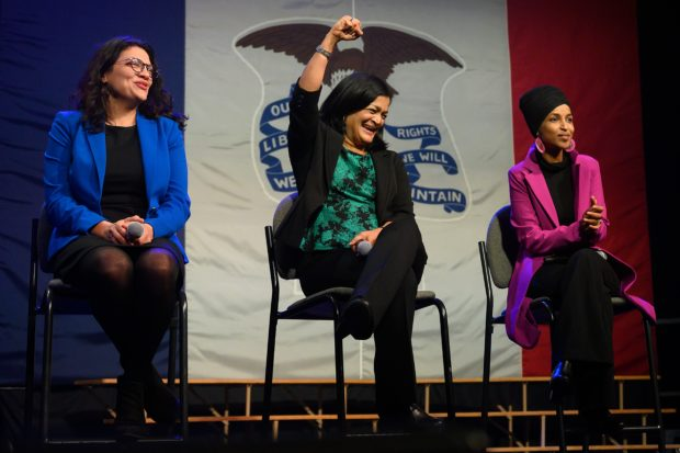 US Congresswoman Rashida Tlaib (L), D-MI, US Congresswoman Pramila Jayapal (C), D-WA and US Congresswoman Ilhan Omar, D-MN, speak to supporters of candidate Senator Bernie Sanders in Iowa, on January 31, 2020. (Photo by JIM WATSON/AFP via Getty Images)