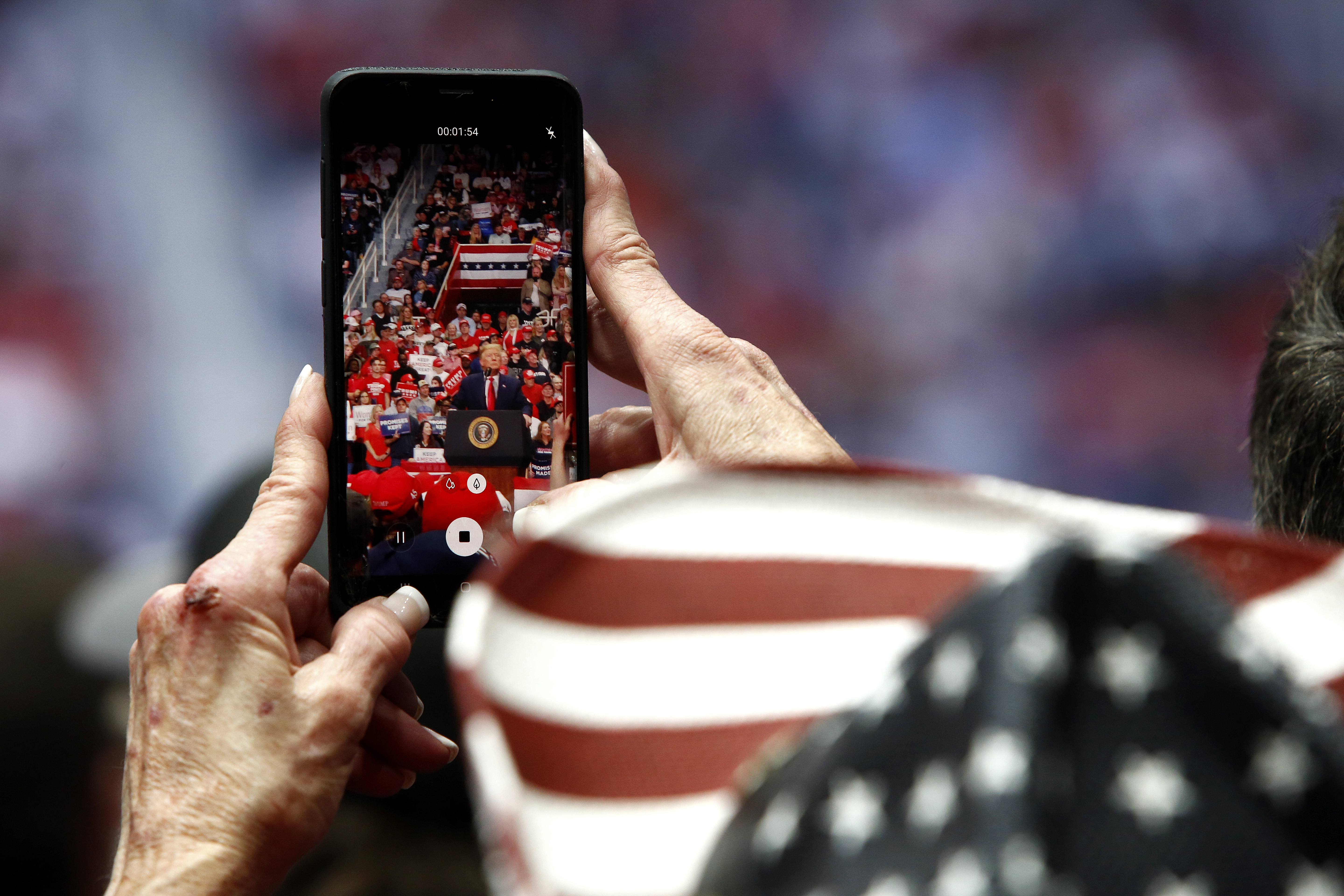 CHARLOTTE, NC - MARCH 2: A supporter films U.S. President Donald Trump as he speaks during a rally on March 2, 2020 in Charlotte, North Carolina. Trump was campaigning ahead of Super Tuesday. (Photo by Brian Blanco/Getty Images)