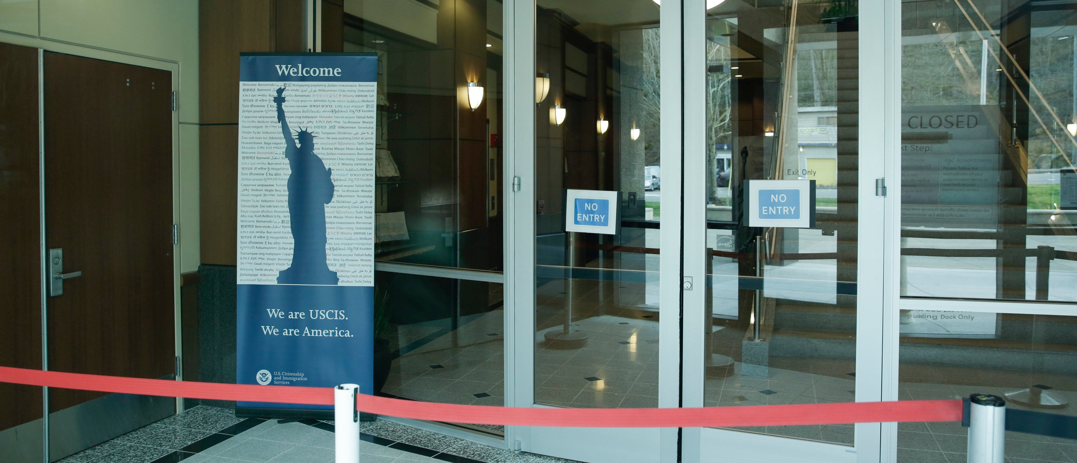 An empty entrance is posted following a two-week closure of a Department of Homeland Security (DHS) building and US Citizenship and Immigration Services (USCIS) field office because of an employee who may be infected with the novel coronavirus in Tukwila, Washington on March 3, 2020. - The US death toll from the new coronavirus epidemic rose to seven on March 3 after authorities confirmed that a nursing home patient who died last week was infected with the disease. All seven US deaths from COVID-19, as the virus is called, have been in Washington state. (Photo by Jason Redmond / AFP) (Photo by JASON REDMOND/AFP via Getty Images)