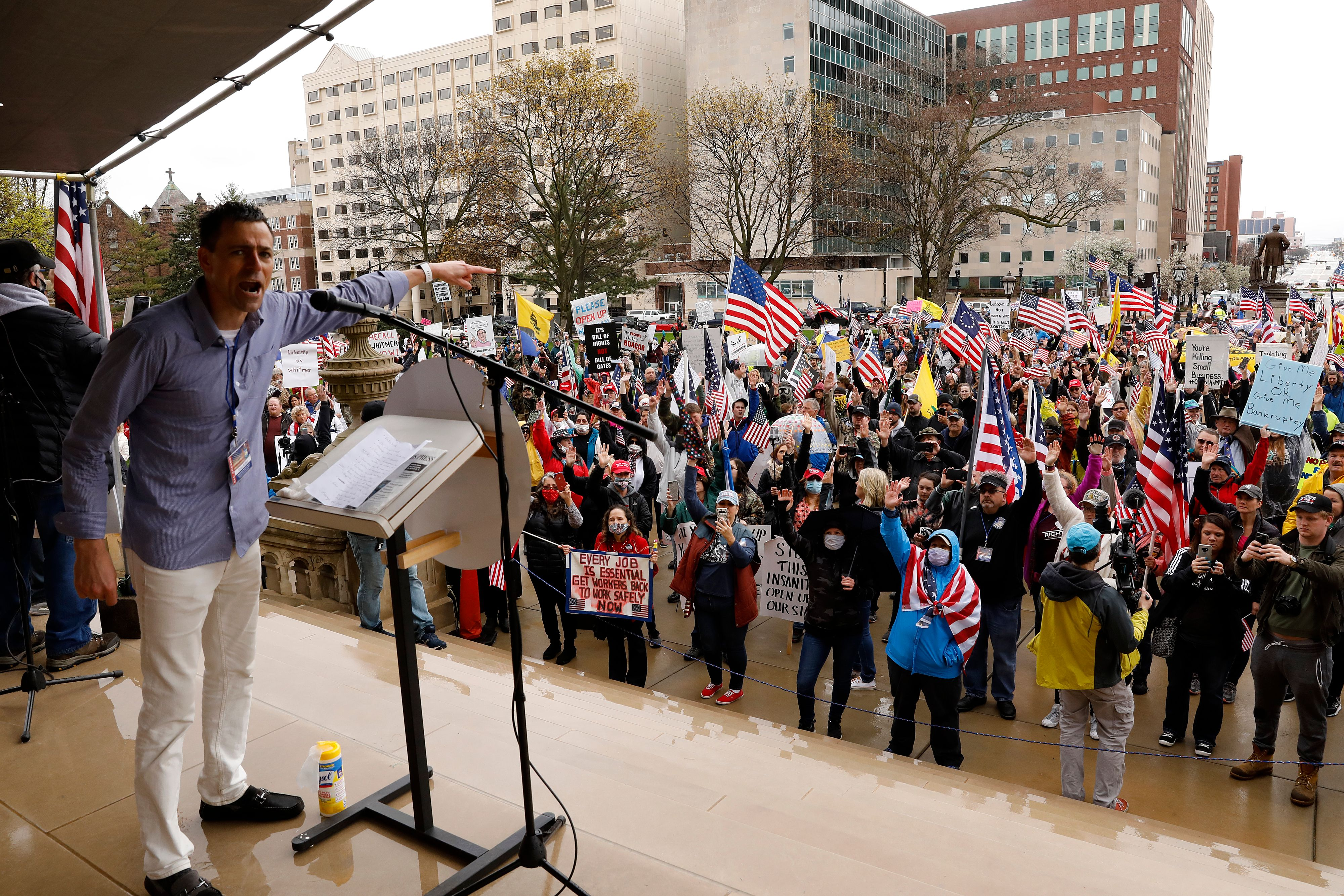Ryan Kelley, a protest organizer, for the American Patriot Rally organized by the Michigan United for Liberty for the reopening of businesses stands on the steps of the Michigan State Capitol in Lansing, Michigan on April 30, 2020. (Photo by JEFF KOWALSKY/AFP via Getty Images)